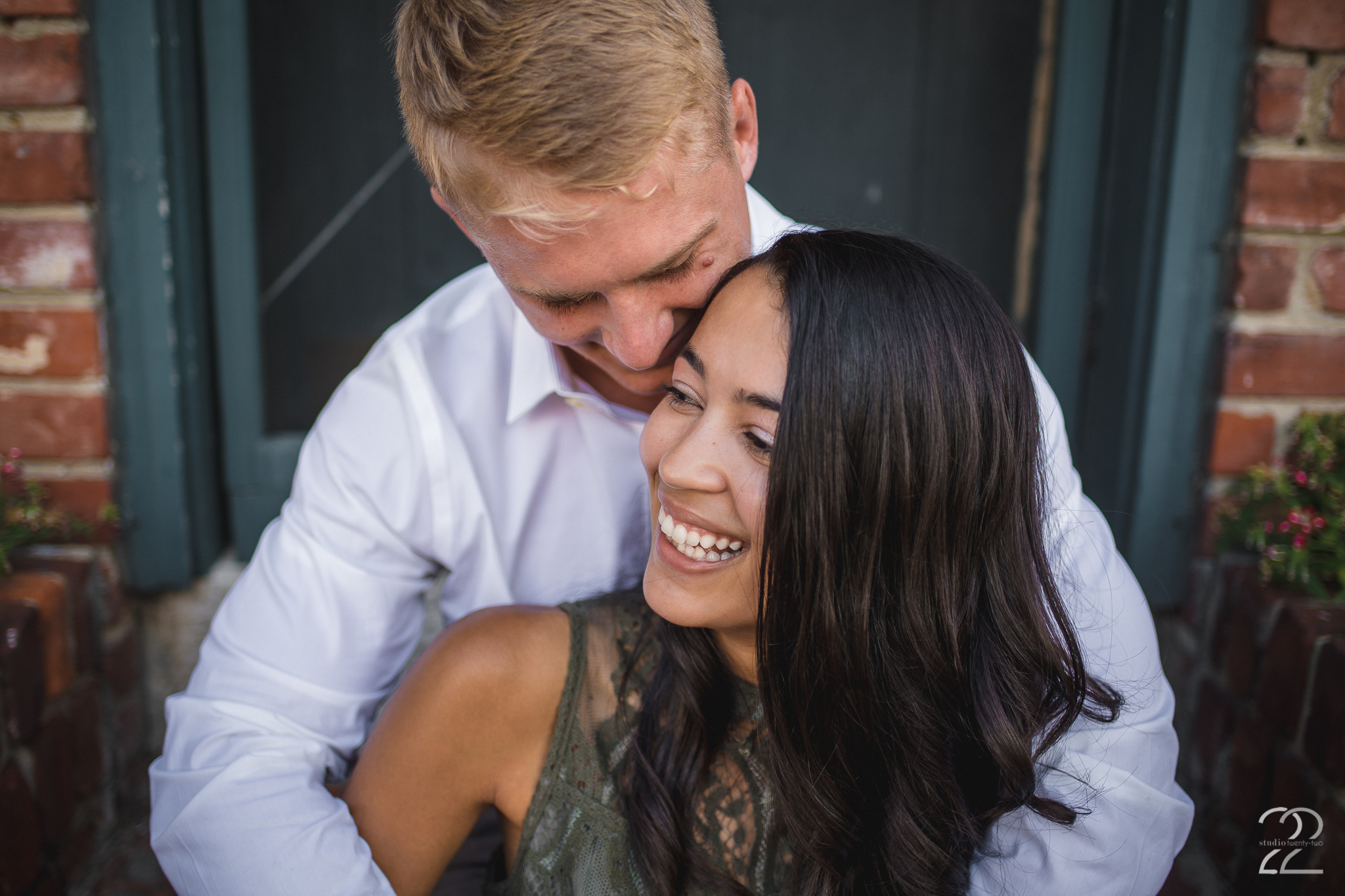 Up close photo of a man wrapping his arms around a woman from behind while sitting on the stairs, in Lebanon, Ohio by Dayton Wedding Photographer Studio 22 Photography