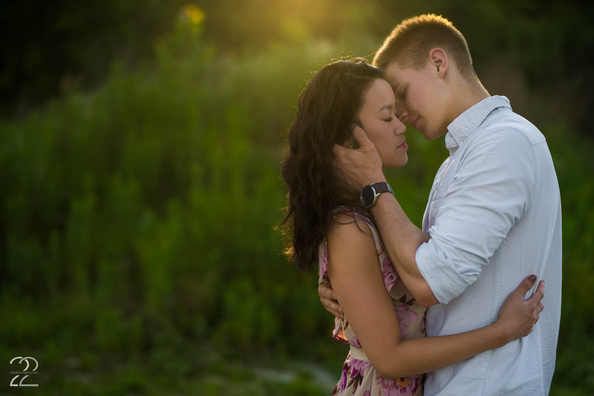 Man brings woman in for a kiss as the sun sets at Oakes Quarry Park by Dayton Wedding Photographer Studio 22 Photography