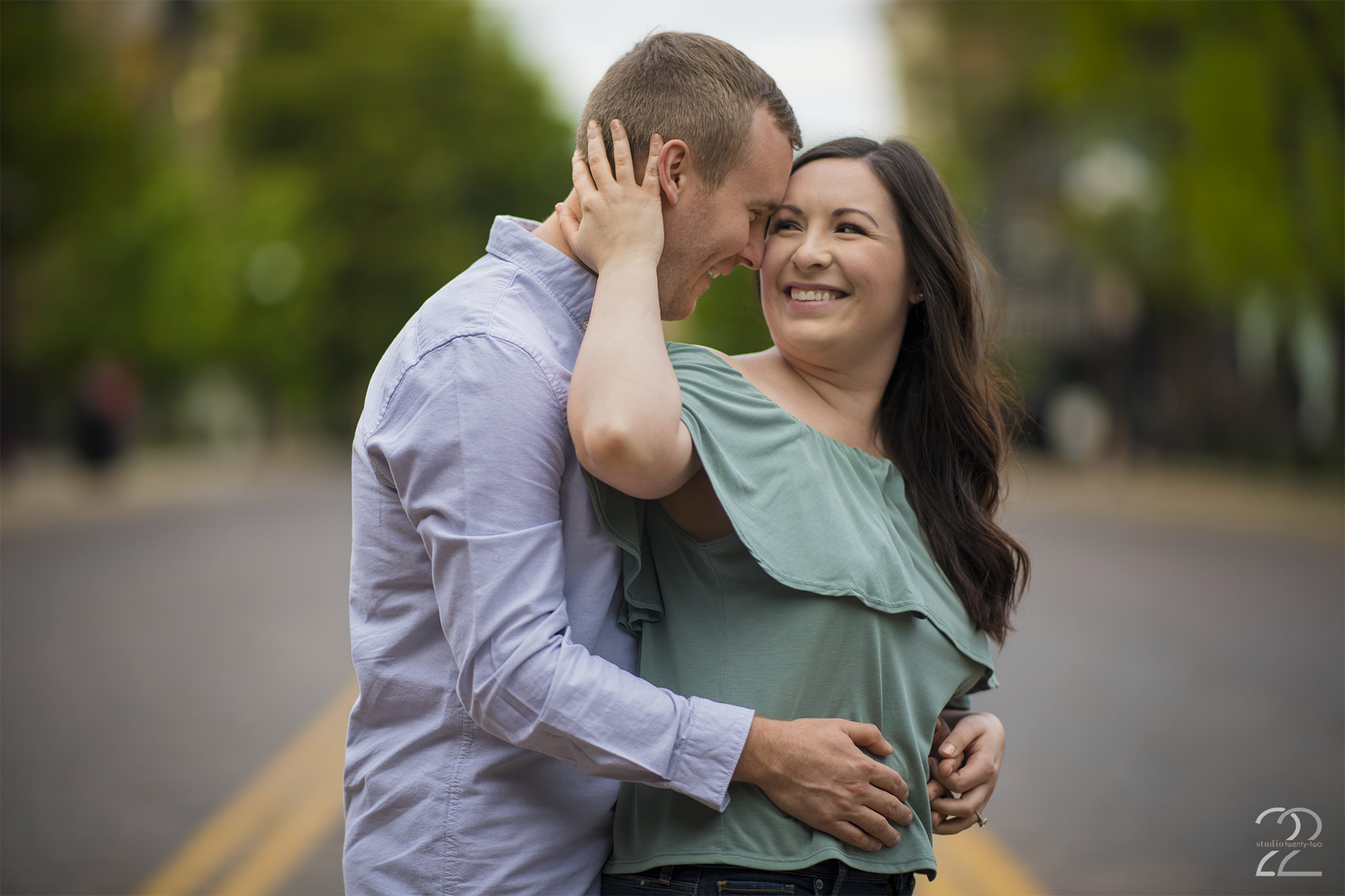 Man and woman embrace and smile in an empty road in the Oregon District by Dayton Wedding Photographer Studio 22 Photography