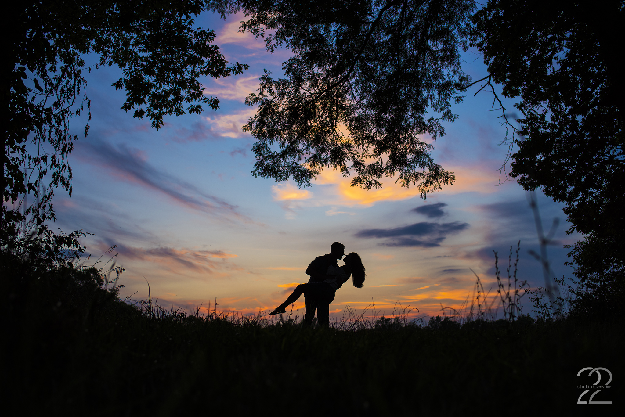 Man dips woman in a field at sunset in Dayton, Ohio by Dayton Wedding Photographer Studio 22 Photography