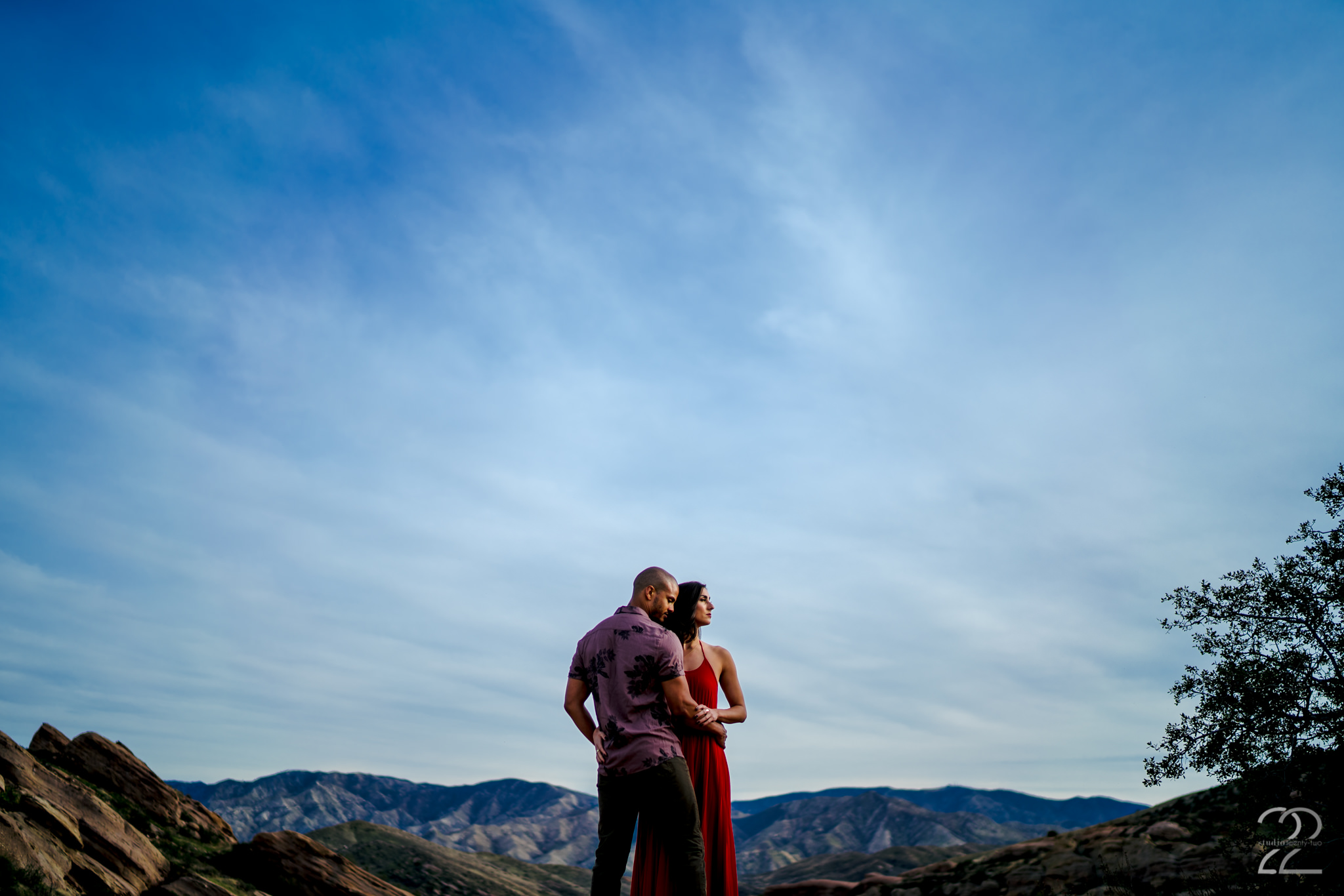 With such beauty as the Vasquez Rocks as a backdrop for a couples, wedding, or engagement session, you cannot go wrong! High on top of a rocky mountain, Michael embraces Natalie as they look toward the sunset. Intimate environmental portraits are always some of my favorites, as it feels like you see the couple being one with nature. The West Coast is always one of my favorite places to be a wedding and engagement photographer, and this time at the Vasquez Rocks did not disappoint!  Sony A7Riii | Sony 35mm f/1.4 @ f/1.4 | ISO 50 |  1/2500 sec | DVLOP presets: Jide Assumpção