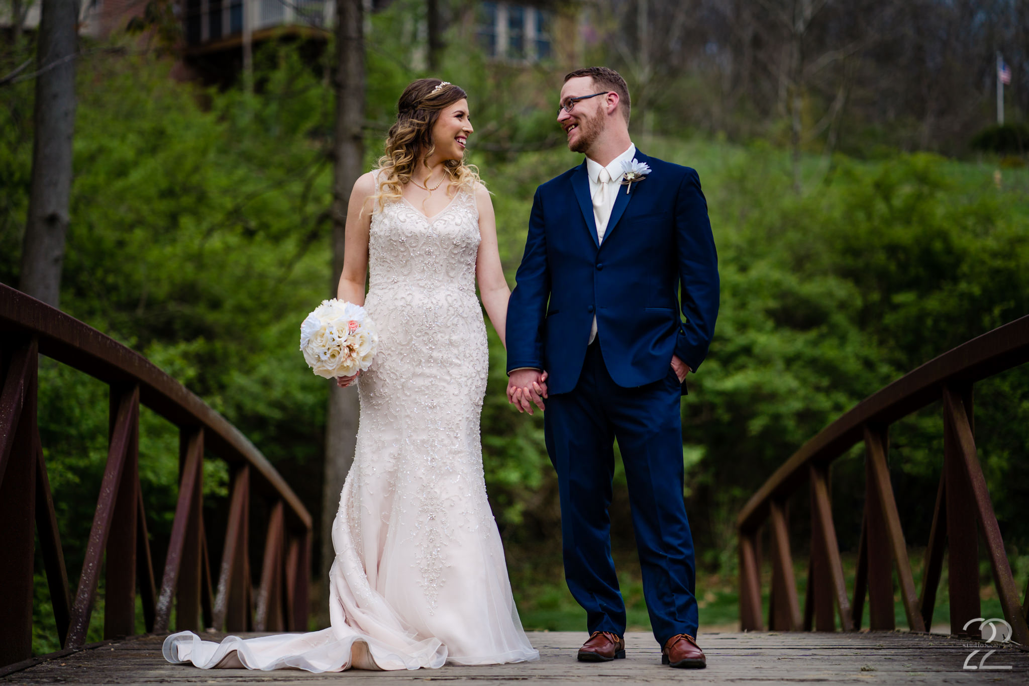 Nick and Erica chose to get married at Aston Oaks Golf Club in Cincinnati, Ohio on a warm spring day. Doing their first look on a beautiful bridge alongside one of Aston Oaks