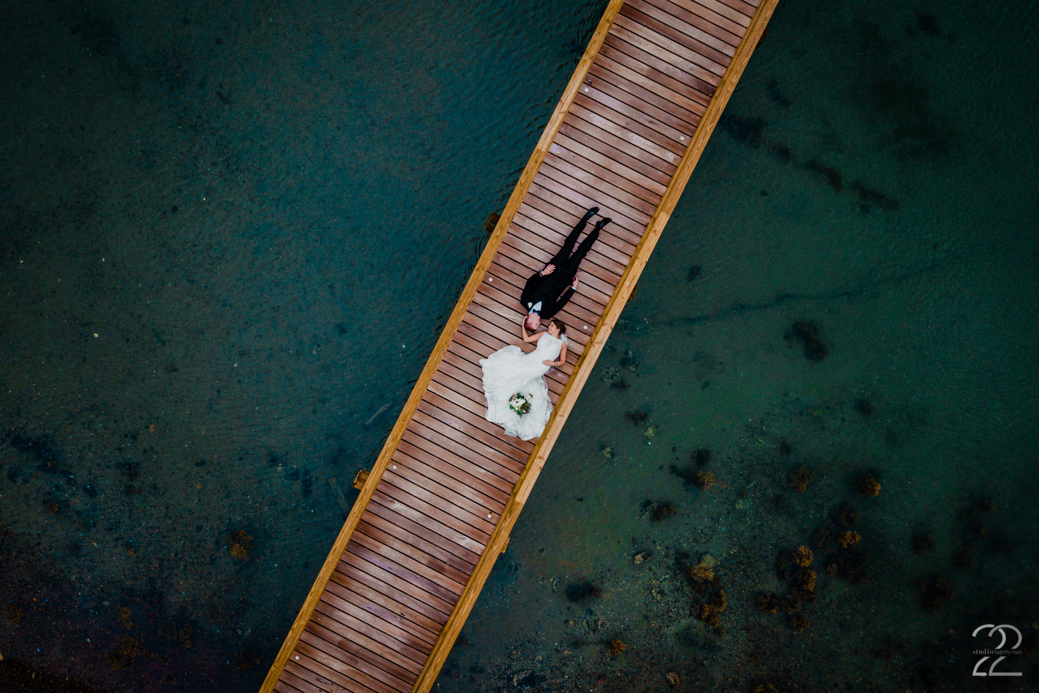 Studio 22 Photography is always working on staying ahead of the game with regards to new photography techniques and gear. Using a drone, Megan was able to create this sensational wedding portrait for Andrea and Patrick at their wedding in Maine.