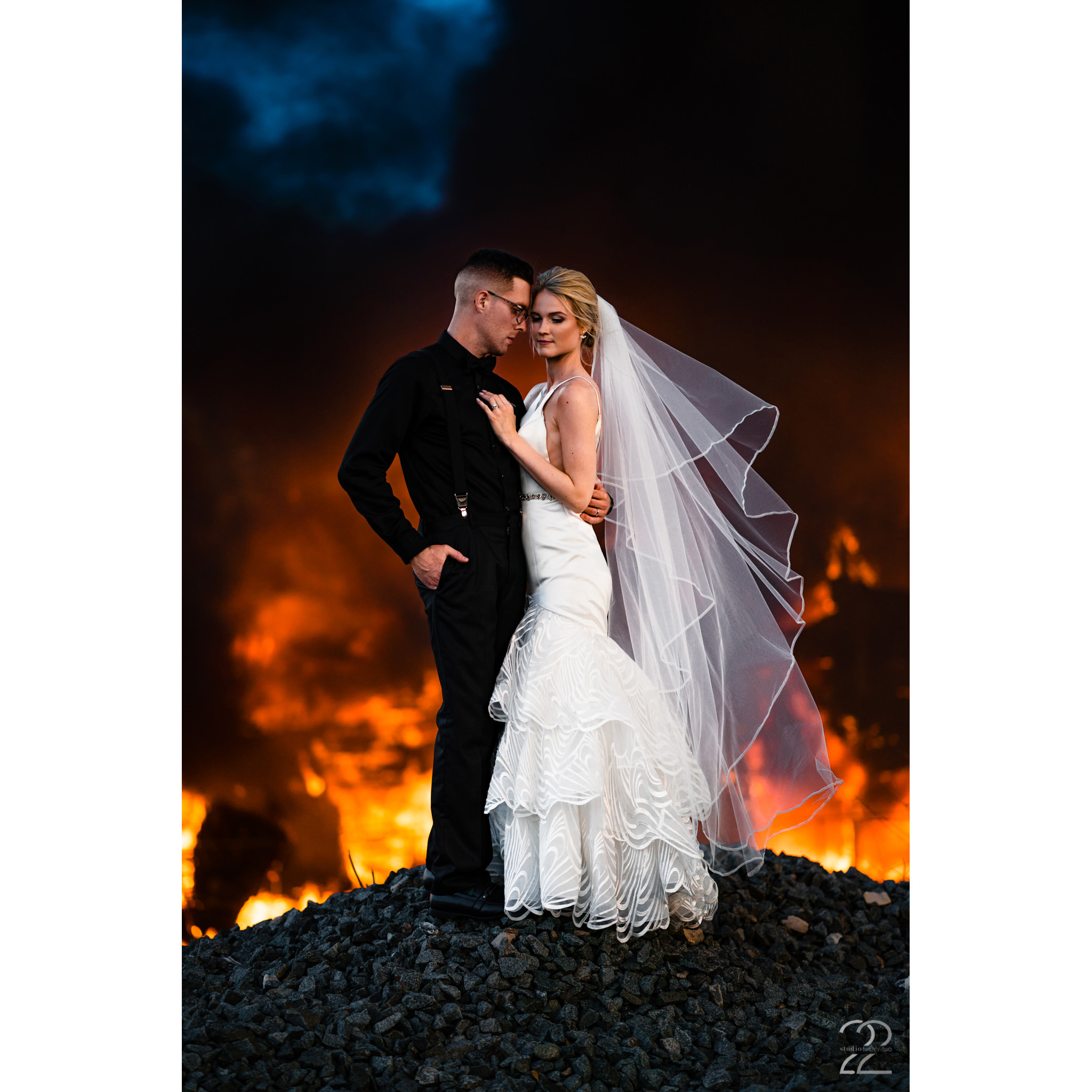 Burning passion… Megan loves when couples ask to do rad things (like take photos at a fire - all rules from emergency personal were respected). When you are open to doing crazy things, beautifully unique wedding portraits are easy to make!