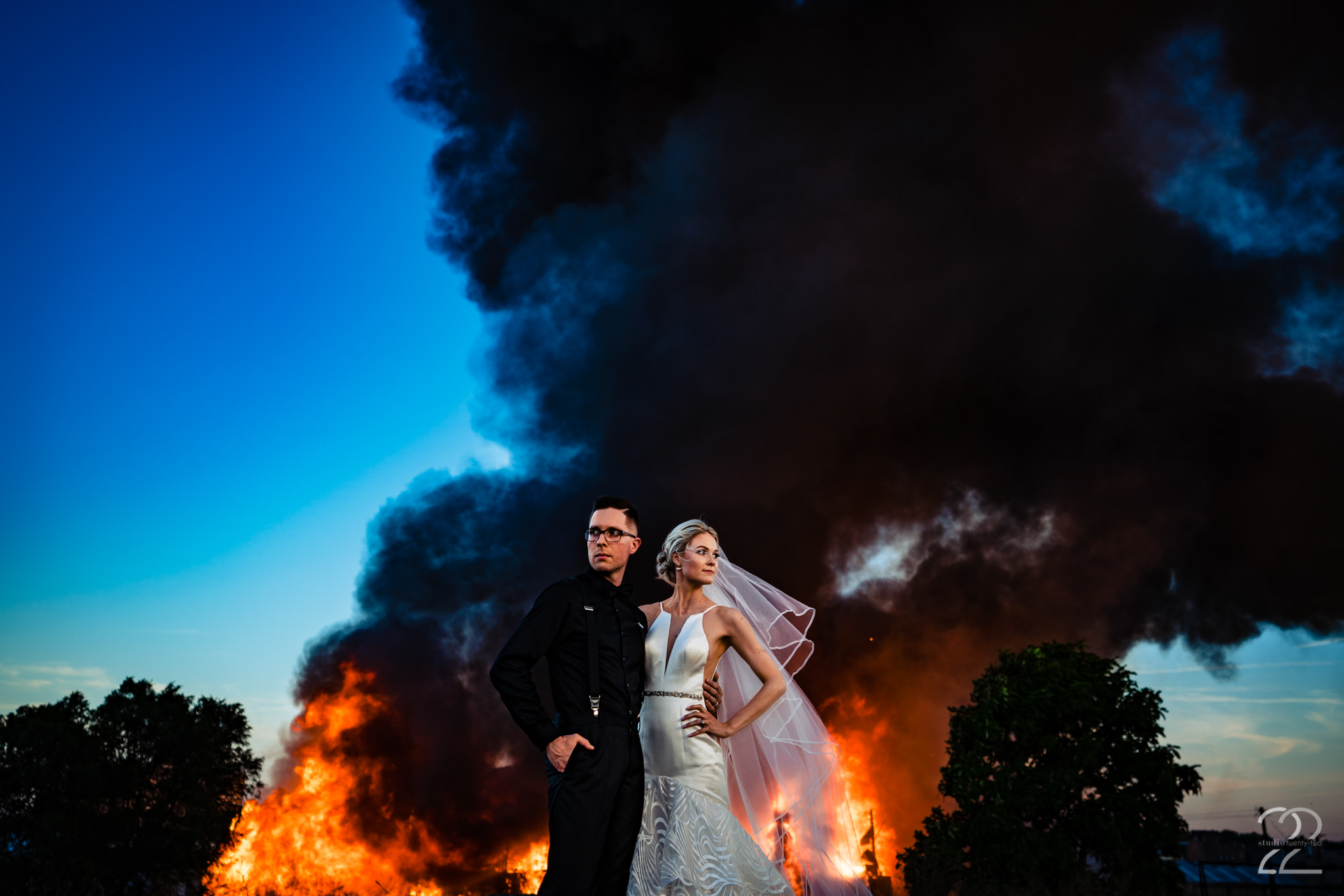 When documenting a wedding, Studio 22 wants you to remember every part of your day (even if that means taking photos in front of a burning building across the street). Dillon and Corrie were so in sync with what they wanted, they came running to get this shot in Dayton, Ohio. This will be a wedding no one will forget, and a photograph for them to talk about for years to come.