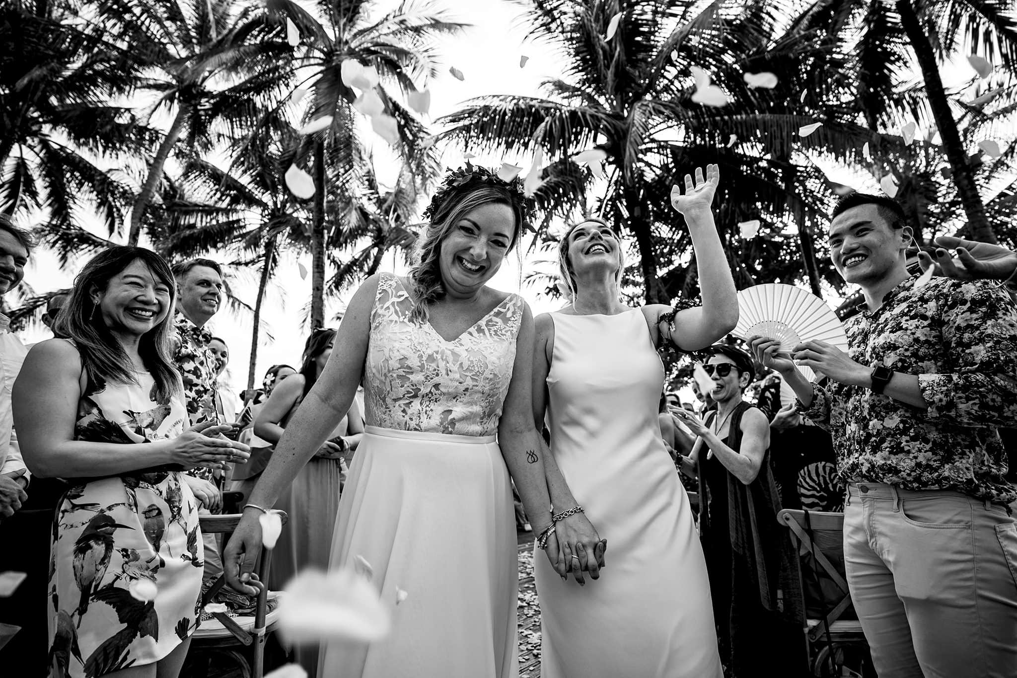 Two brides walk down aisle together