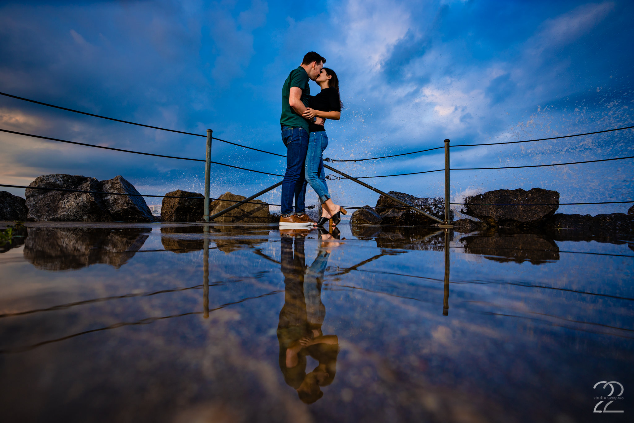 Megan of Studio 22 photography is not afraid to get wet or dirty and loves when couples feel the same. Without willingness of the clients she would never get great surf crashing shots like this!