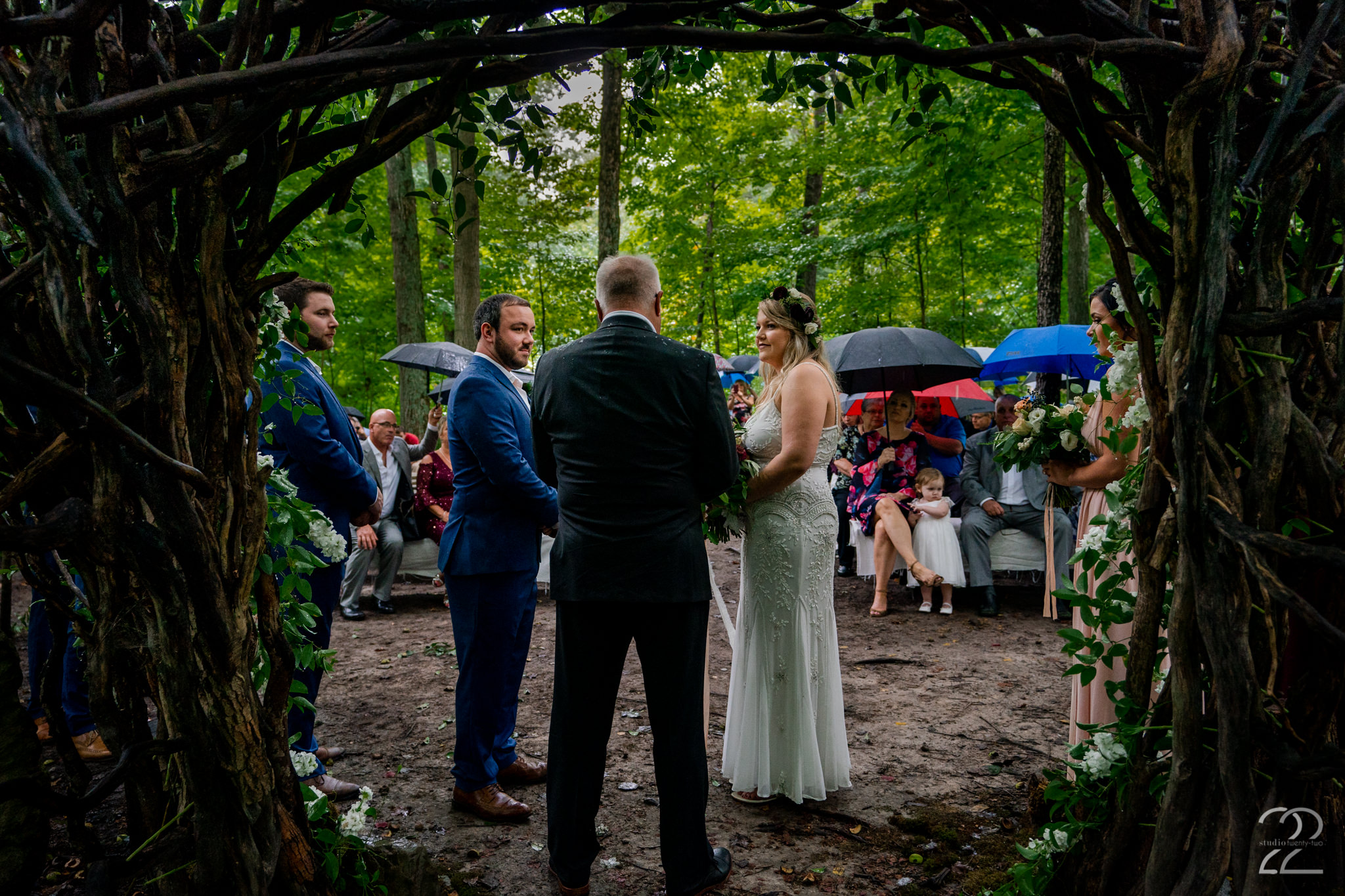 For better or worse, in sun and in rain… a marriage is not about perfection and so we should not expect the wedding day to be either. Tayler and Tyler embraced what some would see as a disaster and made it even more special! A rainy fall forest wedding was one of the most magical weddings that Studio 22 Photography has photographed.