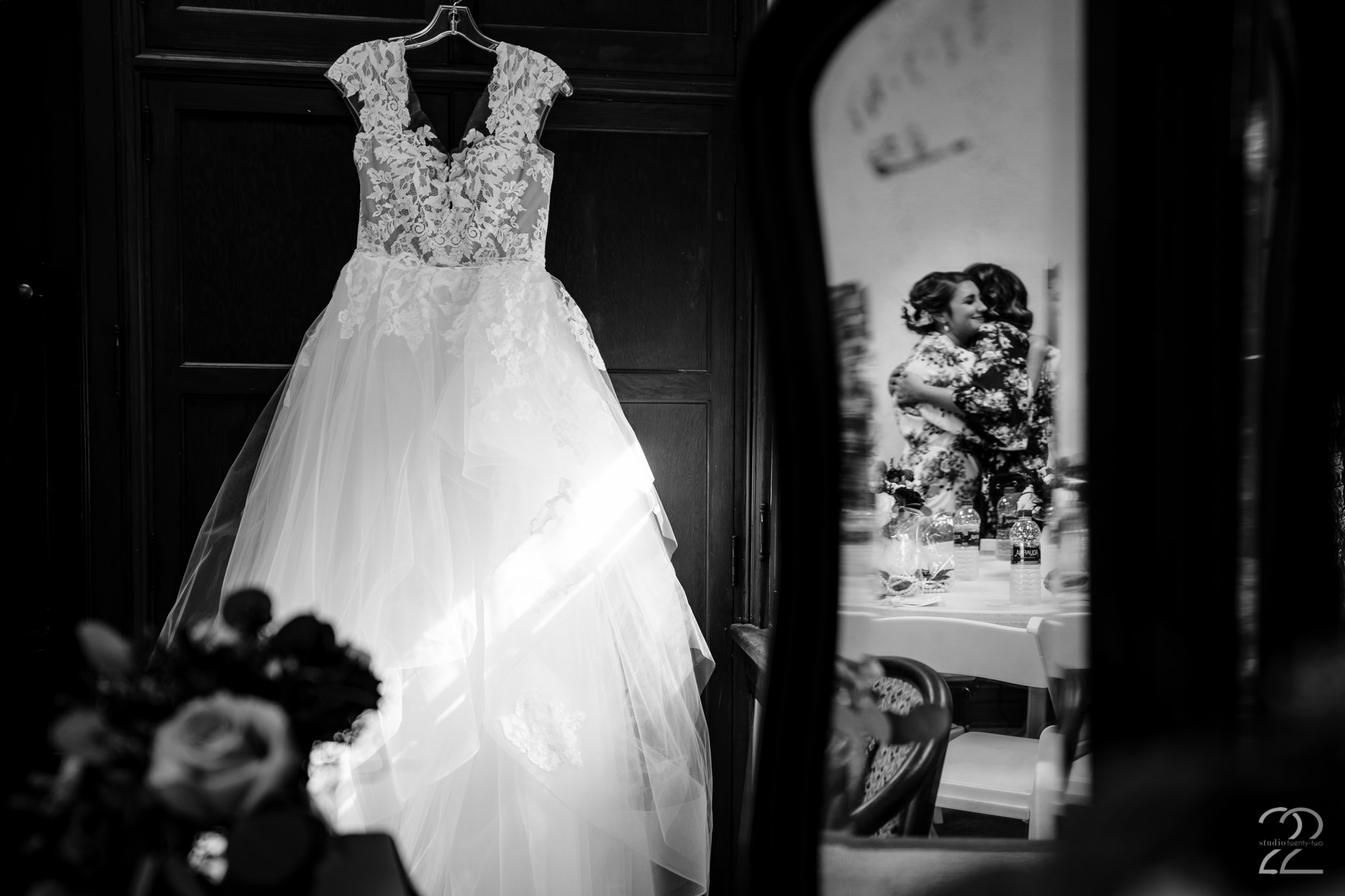 Details mean nothing without the people to enjoy them. Capturing this detail shot of Cassie's wedding dress at Krippendorf Lodge in Cincinnati, with a refection of a genuine emotional embrace, gives what could be a static photo more life and meaning.