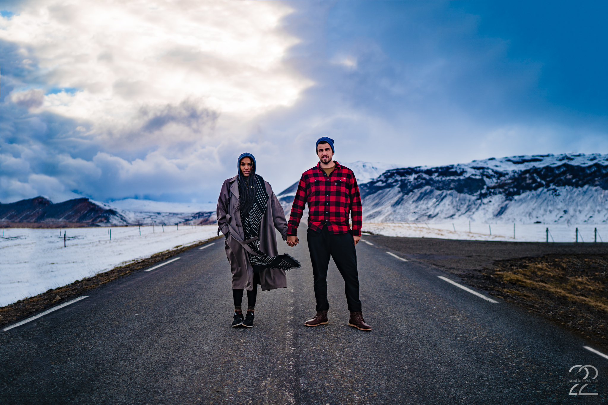 Winter couple's shoots don't have to mean freezing yourselves. Layers, accessories, and pops of colour can create cozy (and warm) portraits. Aubin did a fantastic job at pairing her jacket and scarf on this Iceland photoshoot with Studio 22 Photography.