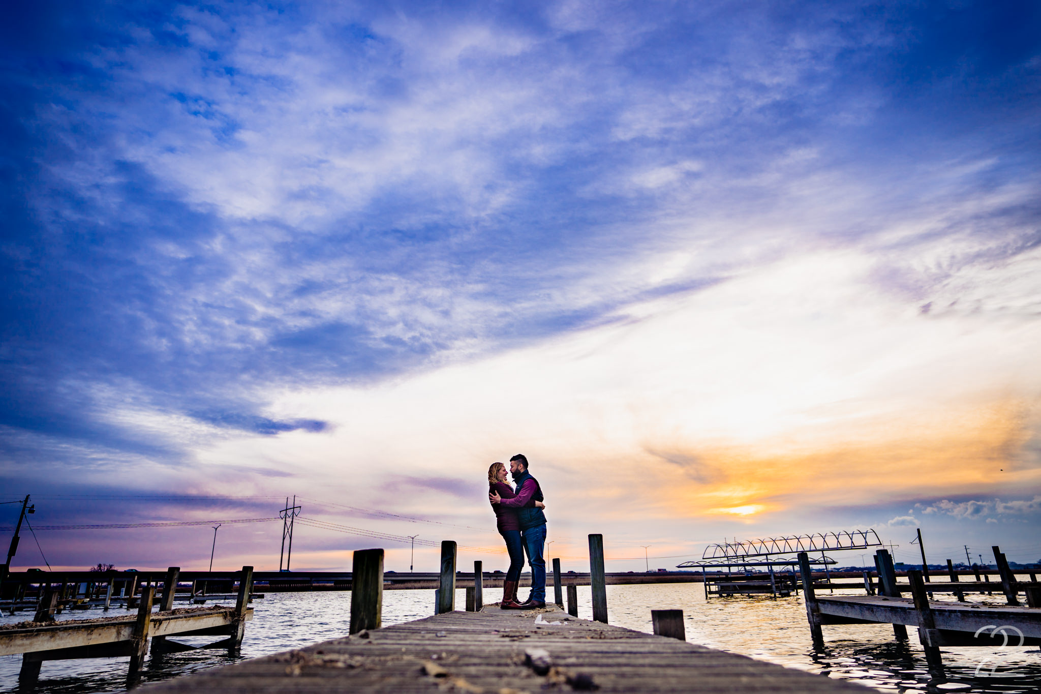 Waterfront views, a cuddly couple and a Madison Wisconsin autumn sunset are the perfect recipe for a piece of art. Megan says an extra word of thanks when nature graces her with something extra special when shooting a couple's shoot.