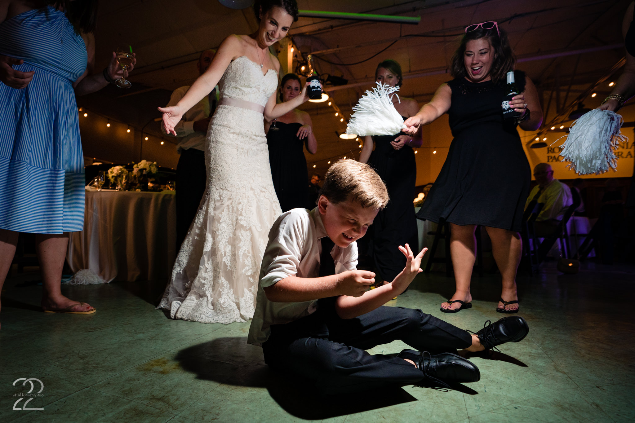 Expect the unexpected and those golden moments will happen. This is part of Megan's philosophy (that and always keep and eye on the kids because they are the true life of the party). Be certain that if Studio 22 is photographing your wedding they won't miss a beat of your epic dance party!