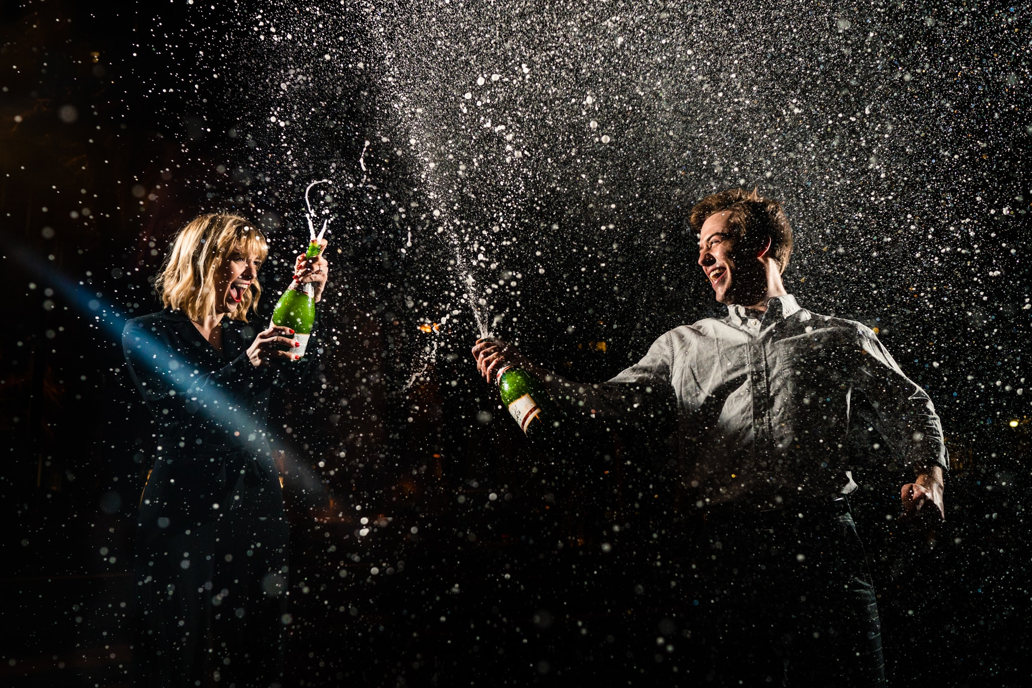 Couple spraying Champagne