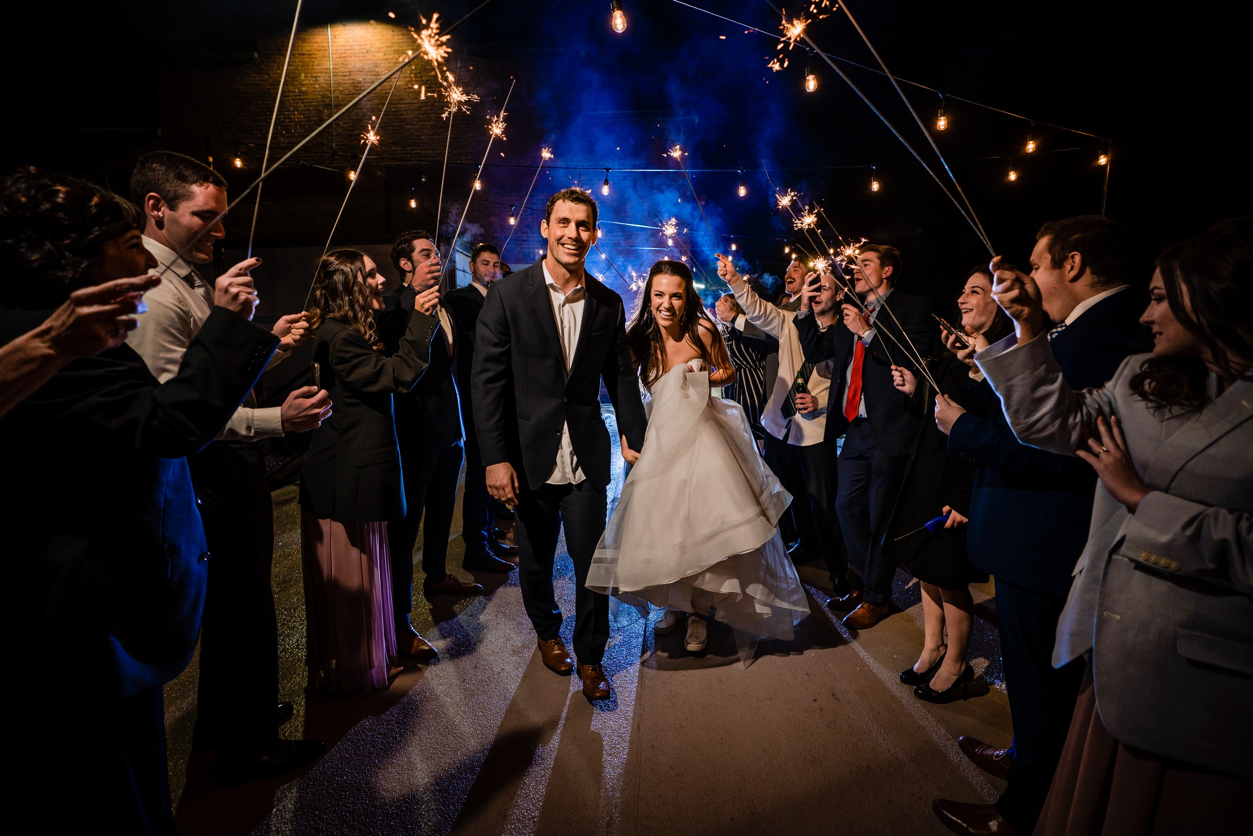 Bride and groom exiting through sparkler tunnel