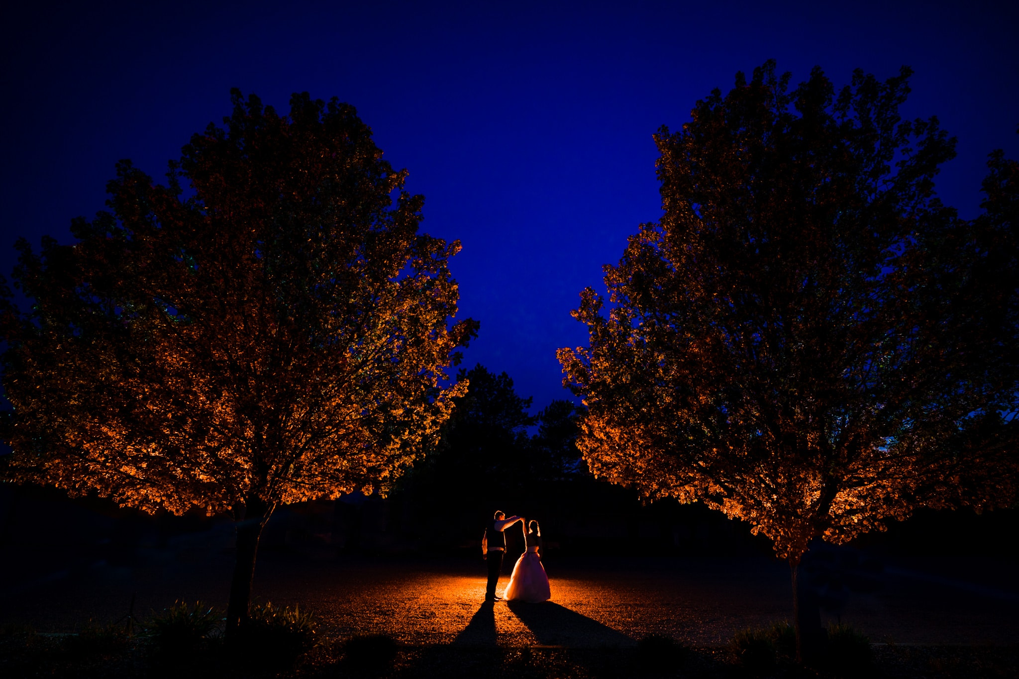 Bride and groom dance at night