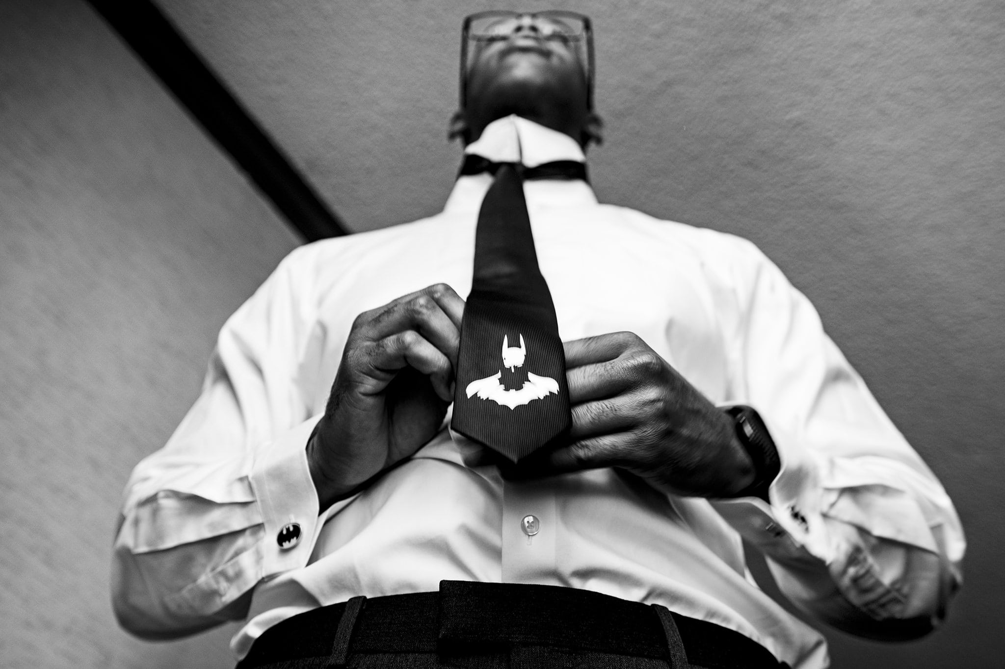 Groom ties Batman tie