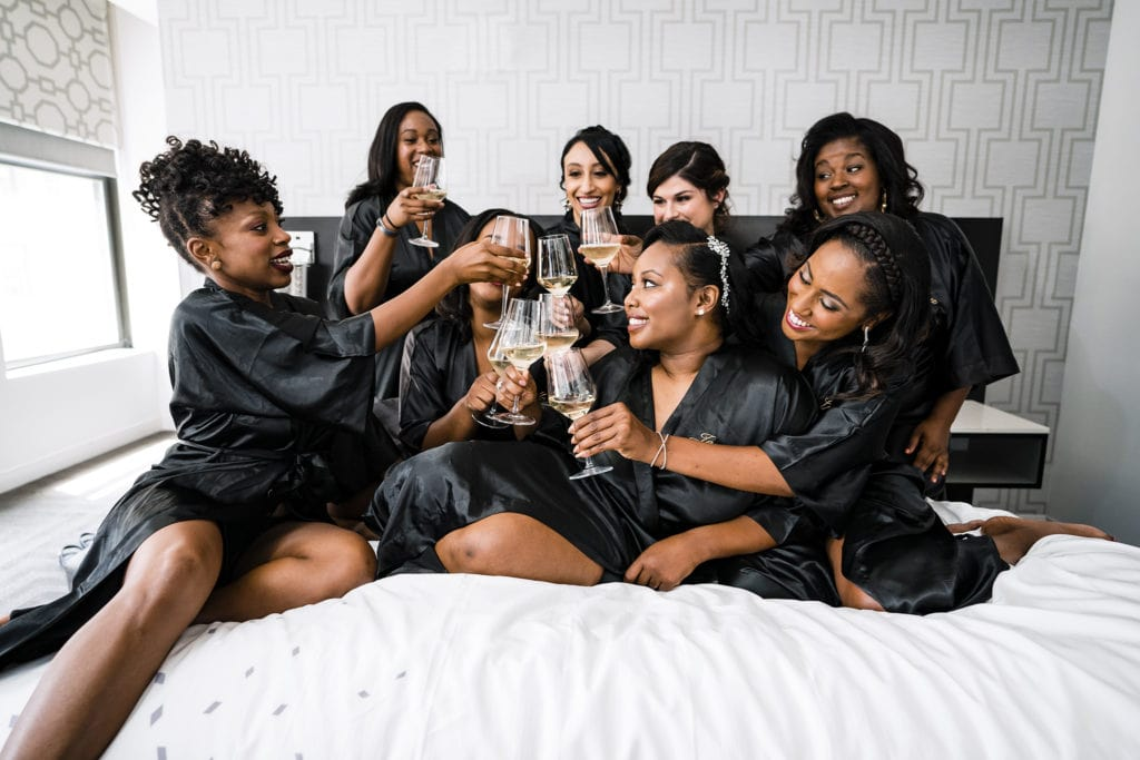 Bridesmaids toast together before the wedding in Cincinnati by Cincinnati Wedding Photographer Studio 22 Photography
