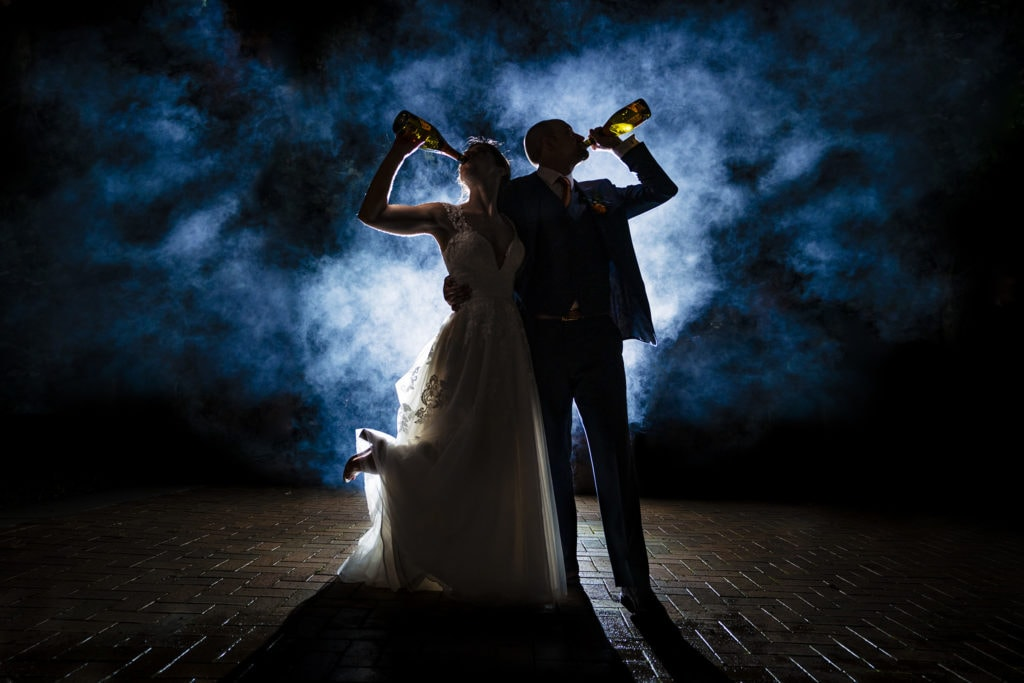 Couple drinks champagne at wedding reception