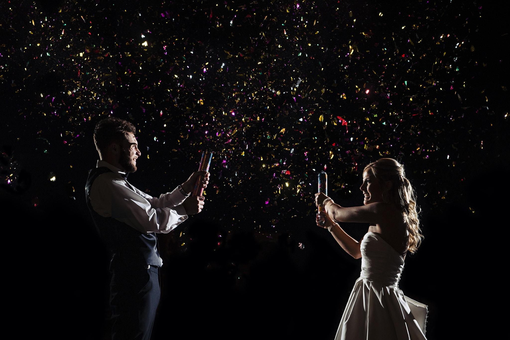 Bride and groom pop confetti