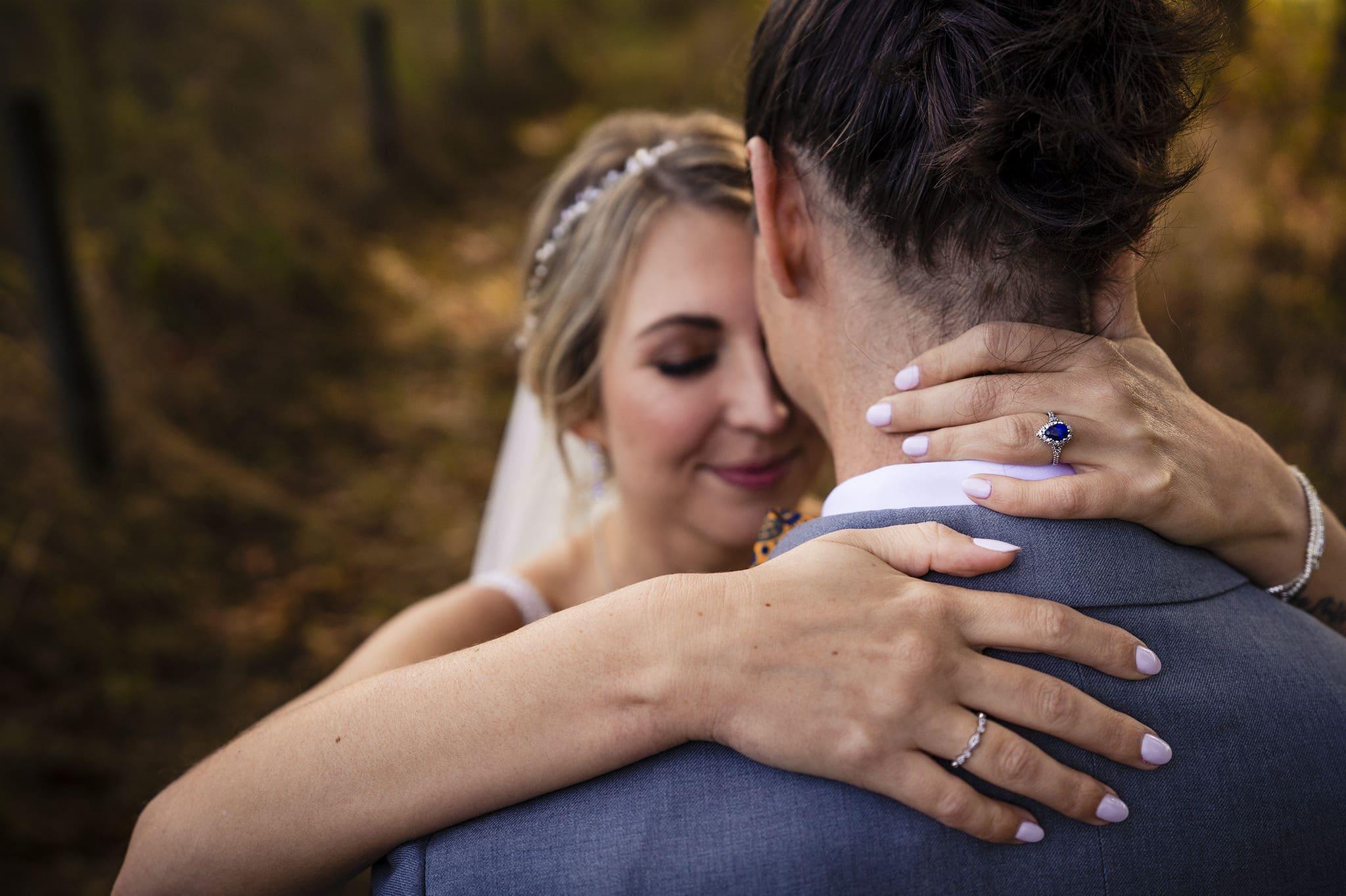 Bride wraps arms around groom