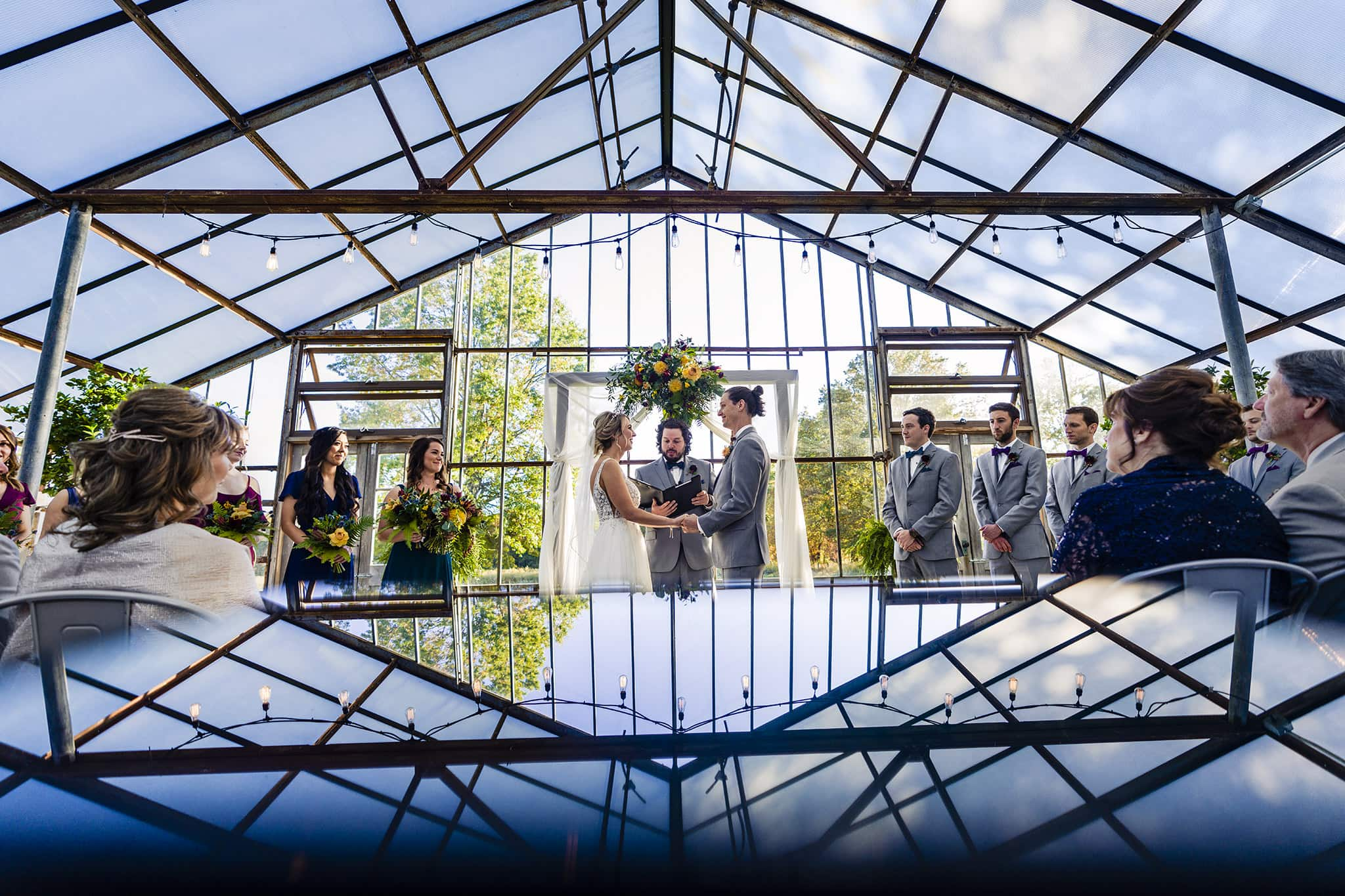 Couple gets married in modern greenhouse venue