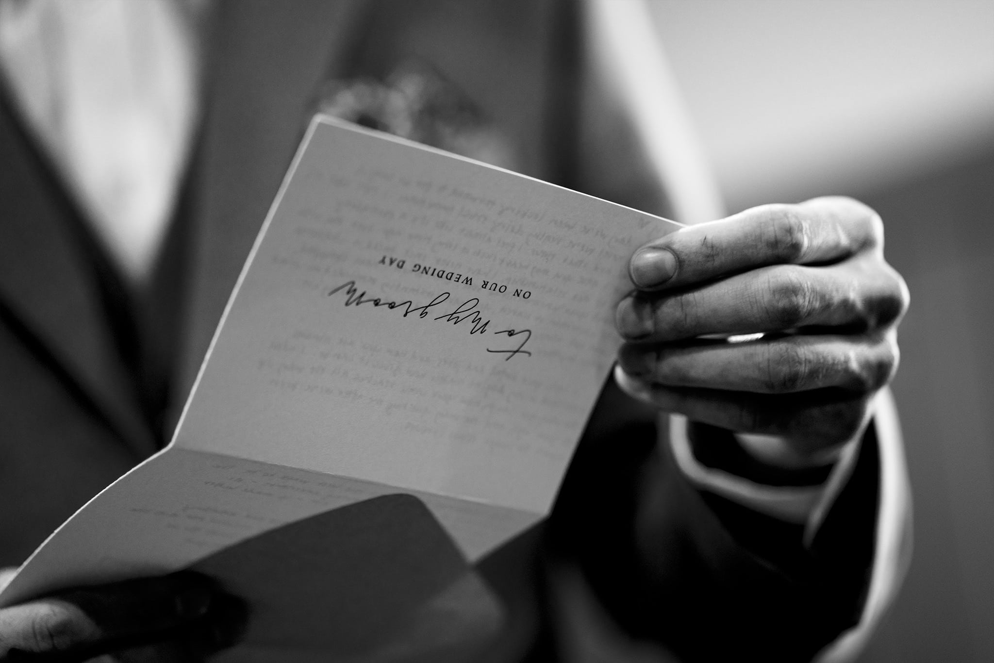 Groom opens note from bride on wedding day