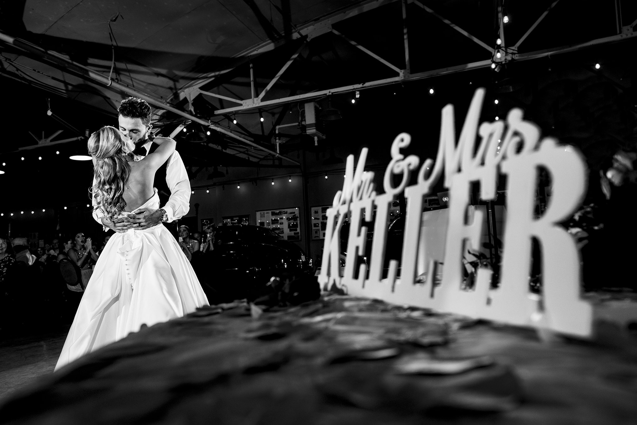 Bride and groom kiss during first dance