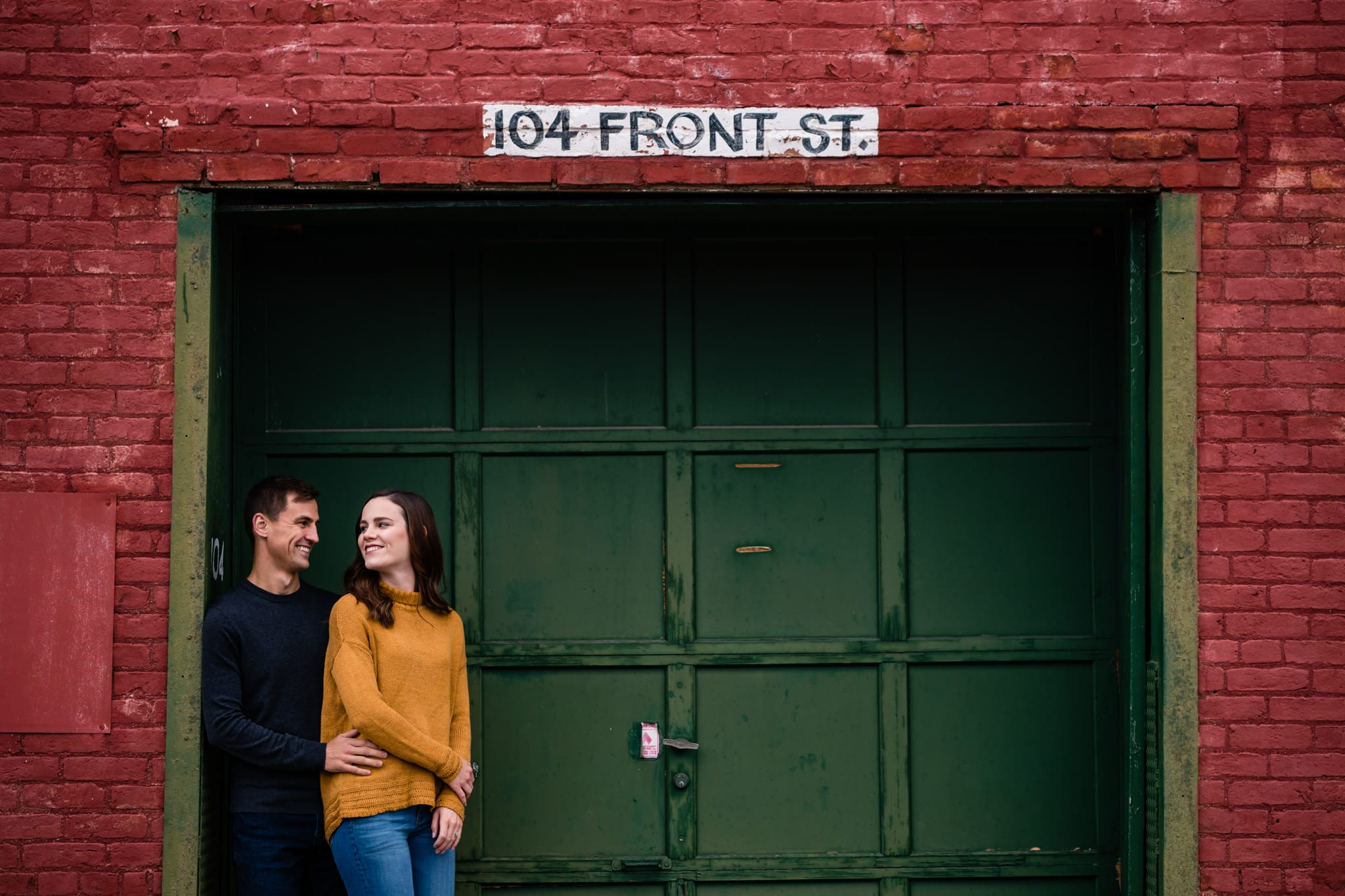 Man and woman standing in doorway at Front Street Markets in downtown Dayton by Dayton Wedding Photographer Studio 22 Photography