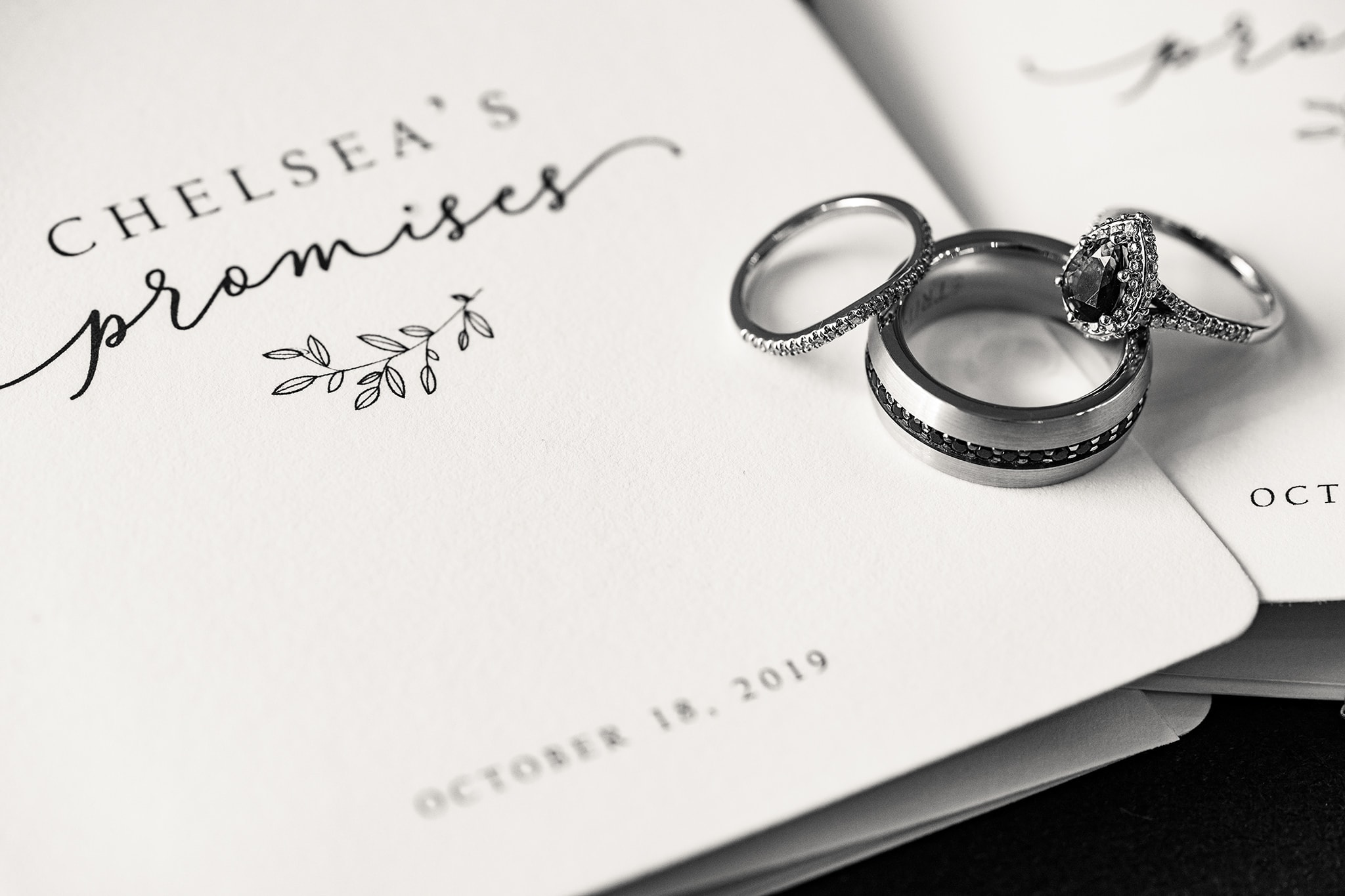 Wedding rings sitting on wedding vow books