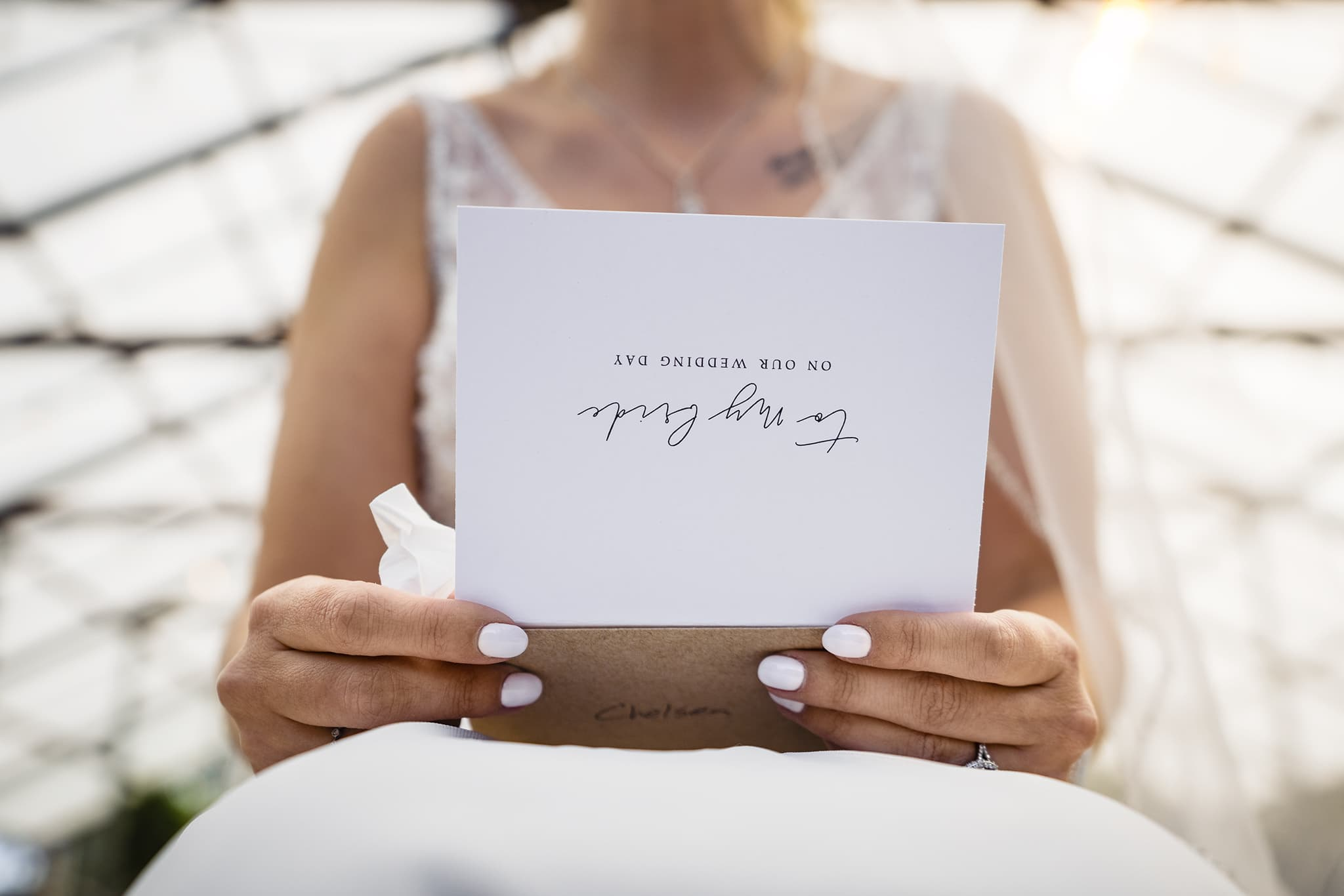 Bride reading wedding day letter