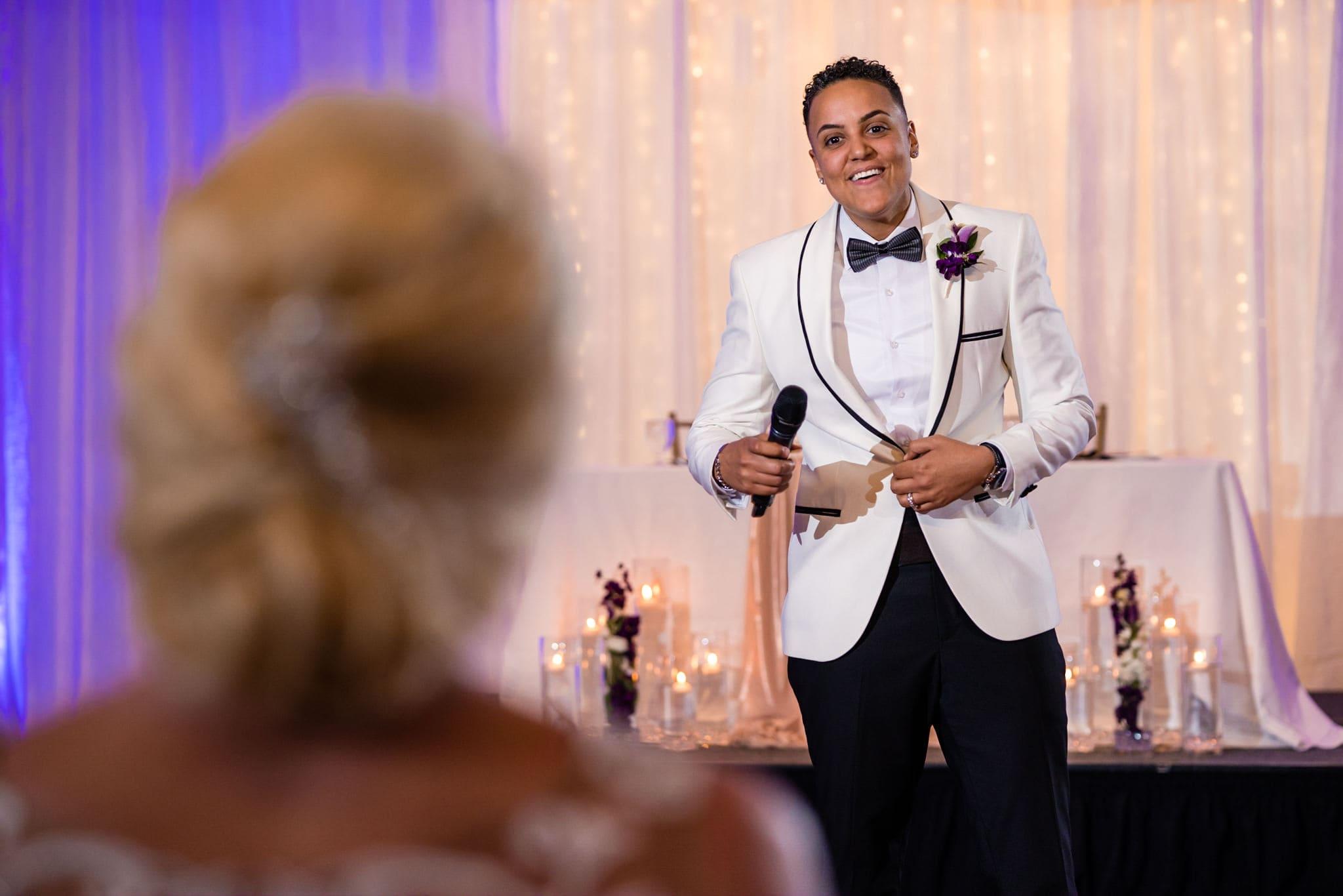 Bride sings to bride at wedding