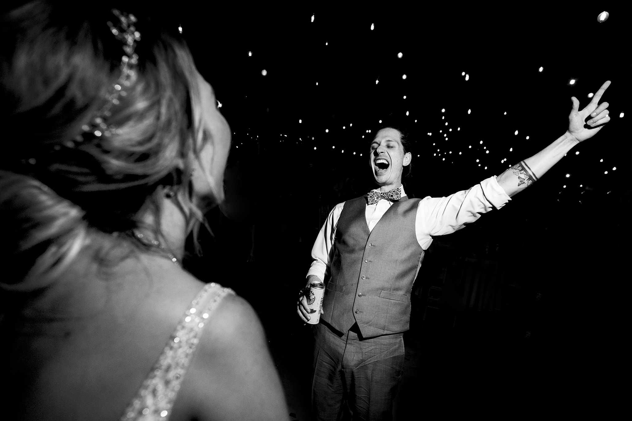 Groom singing and dancing at wedding reception