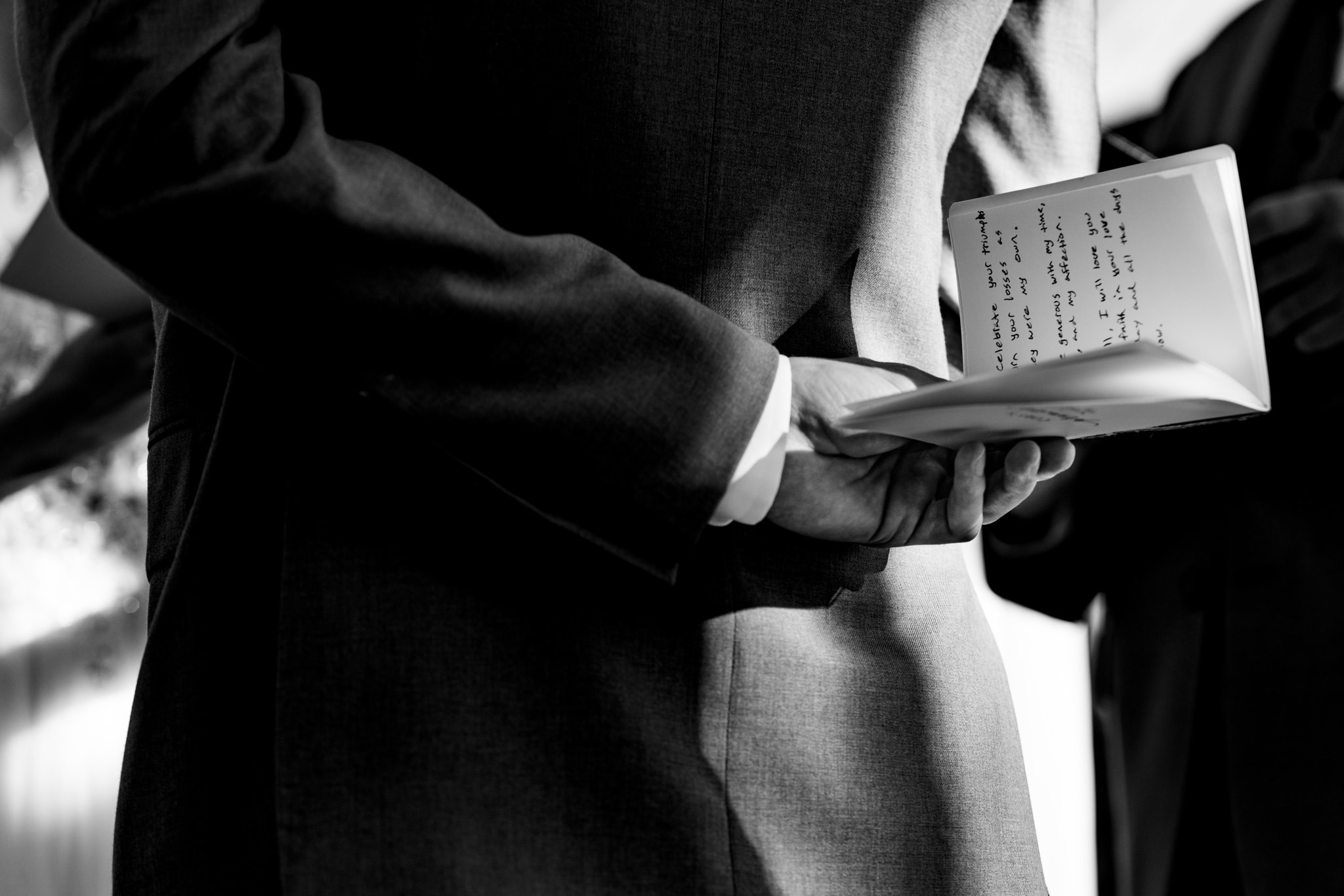 Groom holds wedding vows behind his back