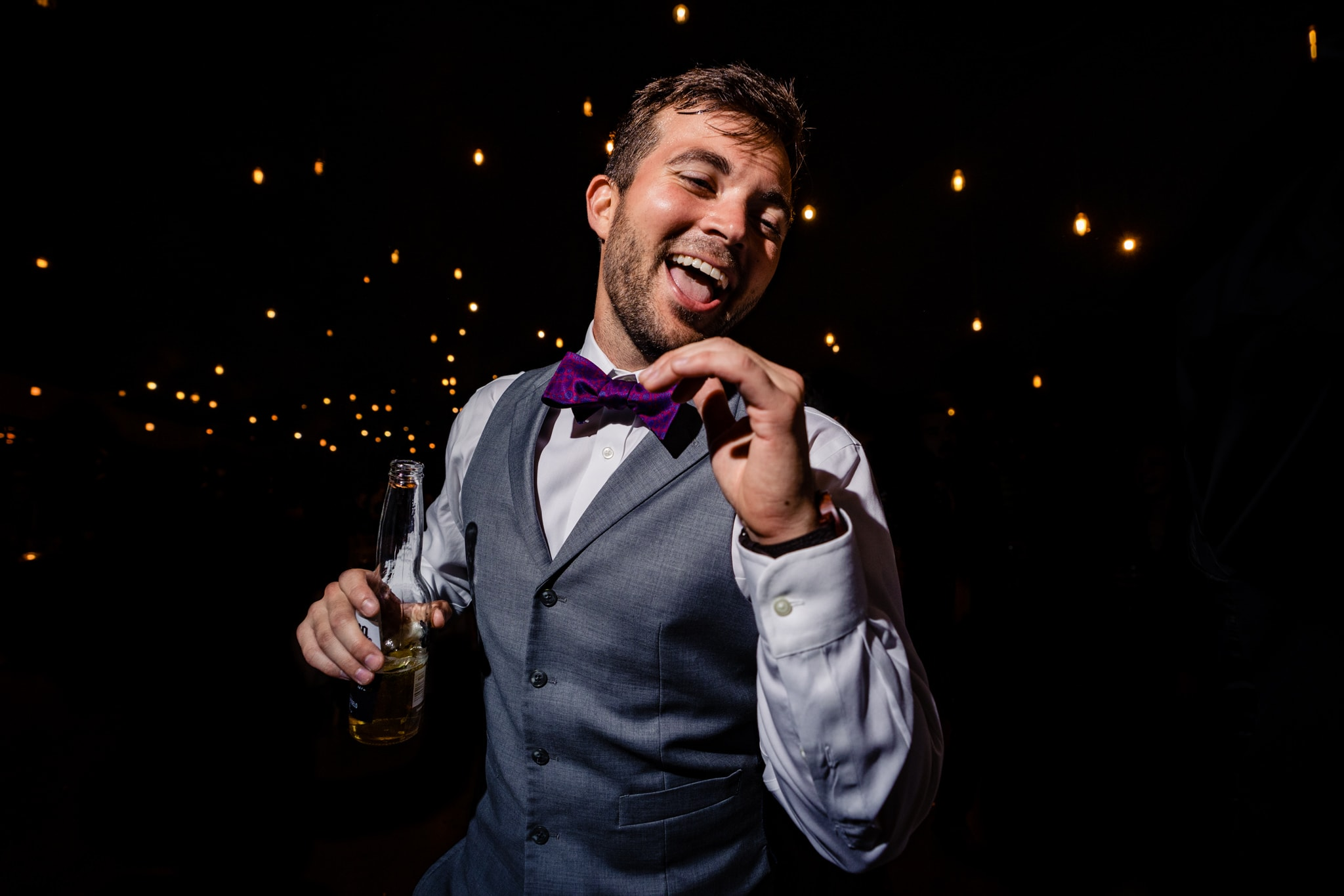 Wedding guest dancing at reception