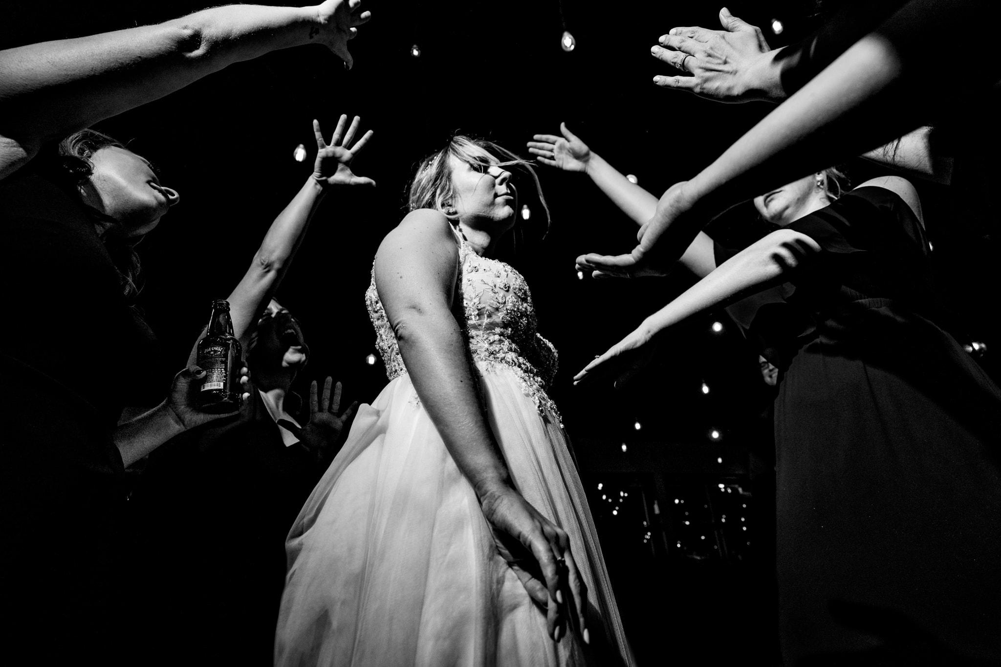 Bride dancing at modern greenhouse wedding reception