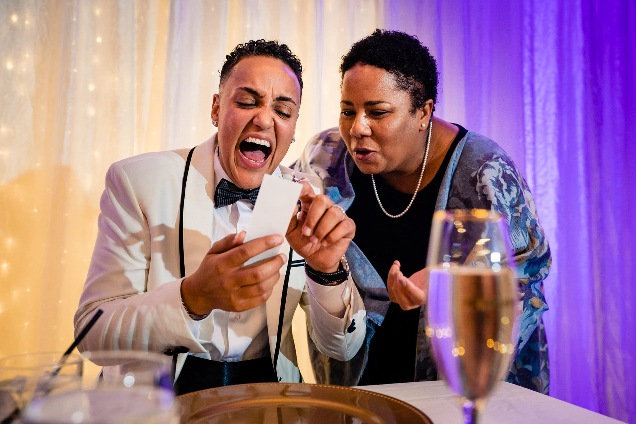 Bride laughing with wedding guest