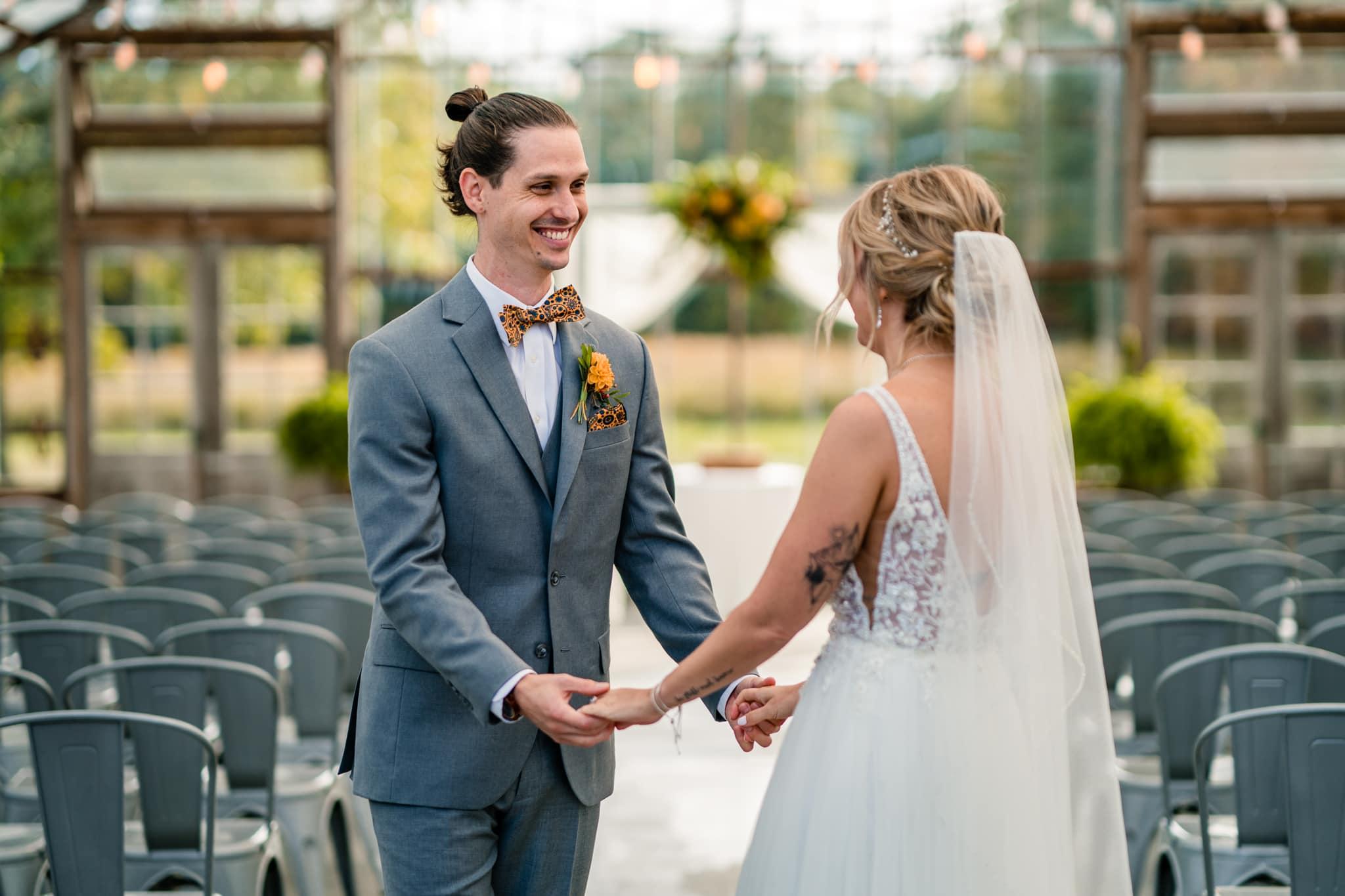 First look in modern greenhouse wedding