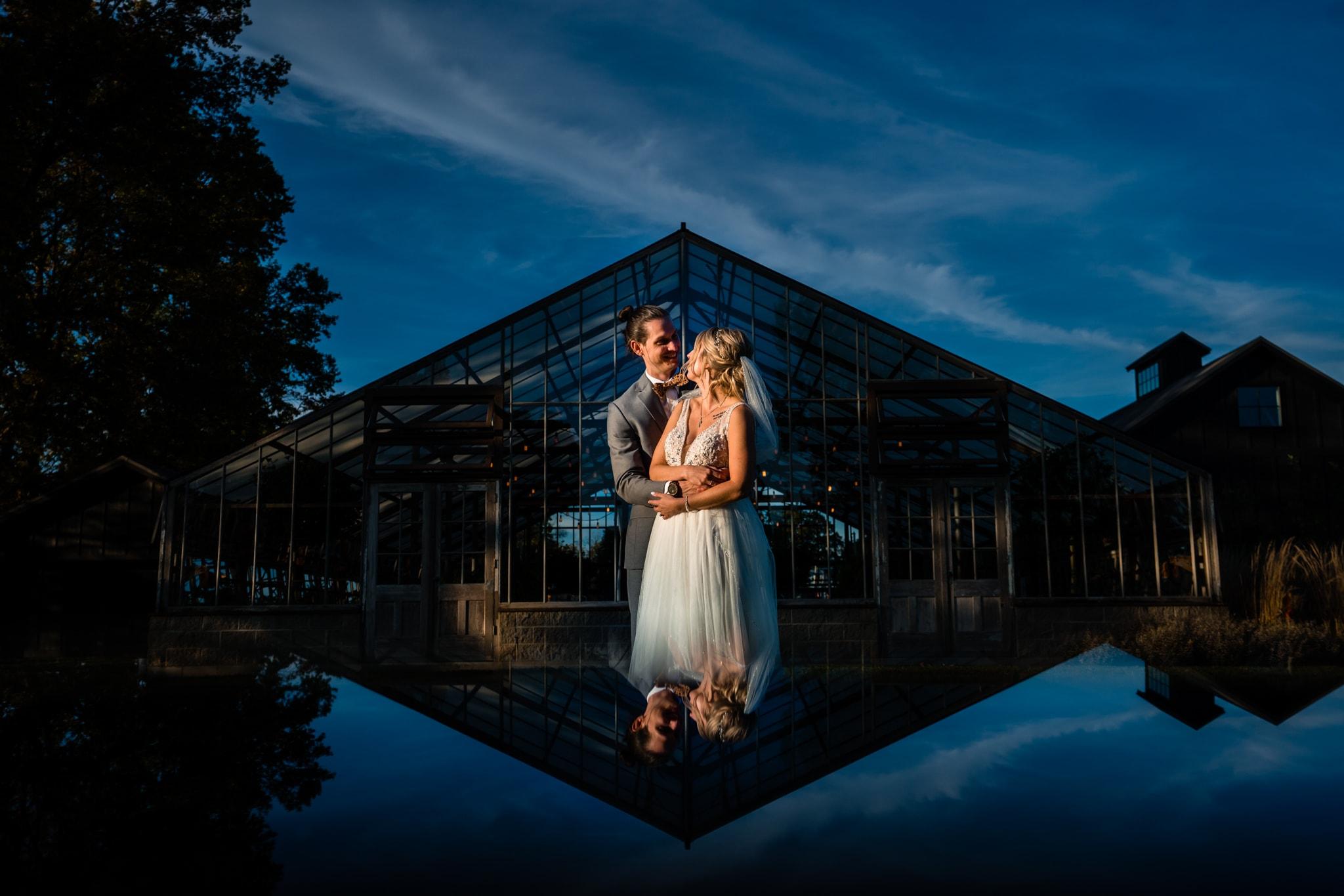 Wedding couple outside of a modern greenhouse