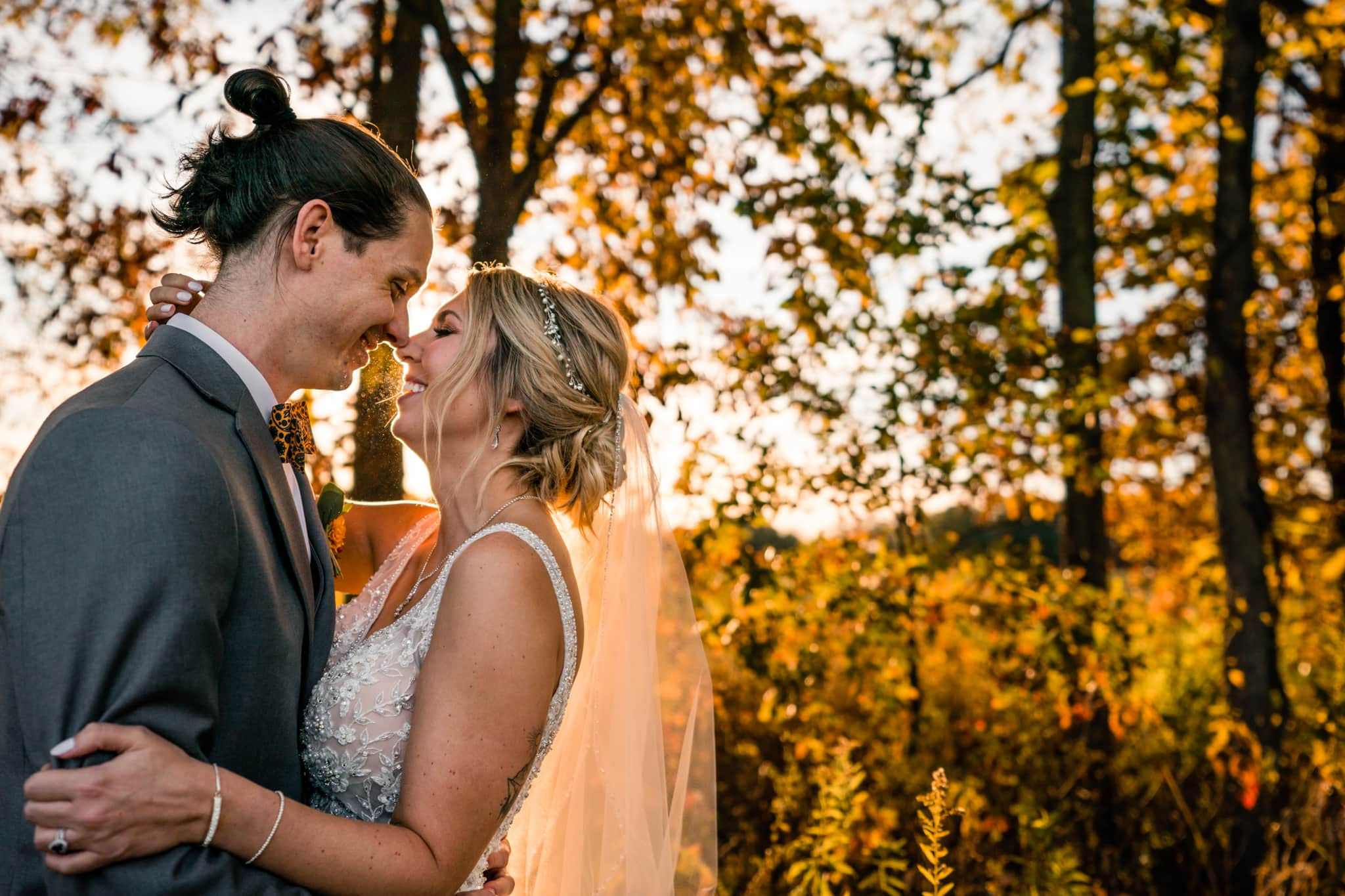 Bride and groom laugh together while hugging