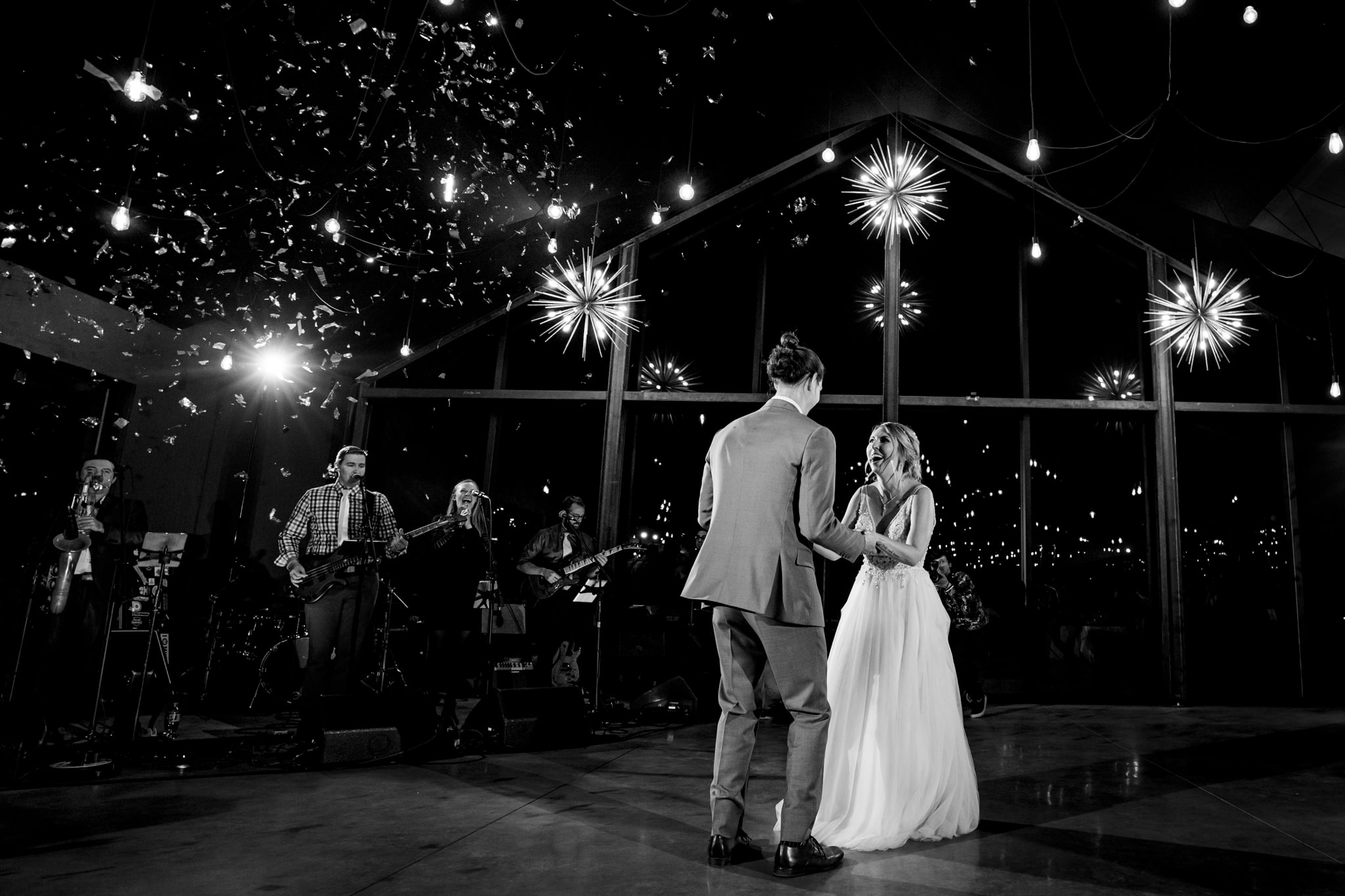 Bride and groom dancing with confetti raining down