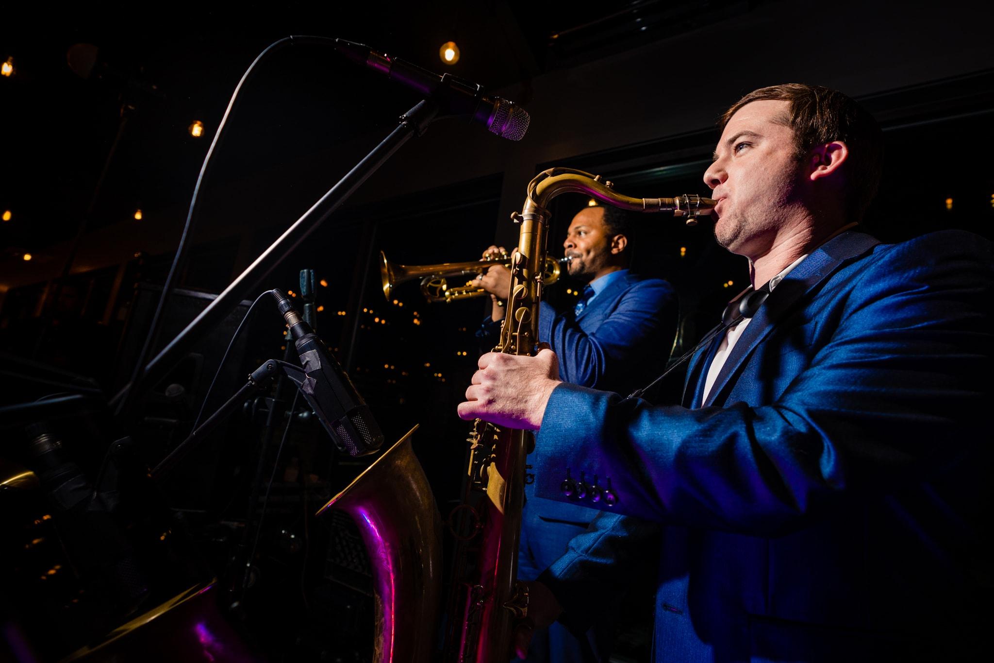 Saxophone player at modern greenhouse wedding