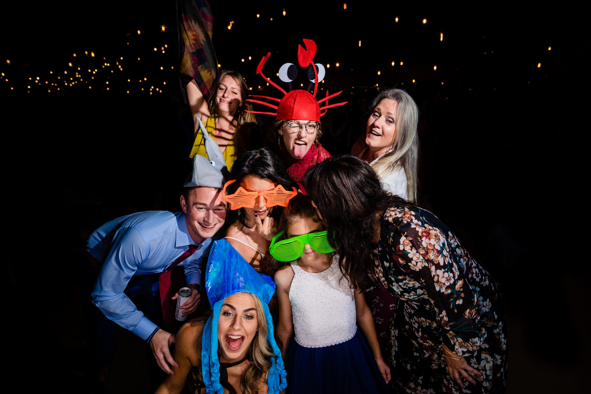 Group of wedding guests post for a silly photo