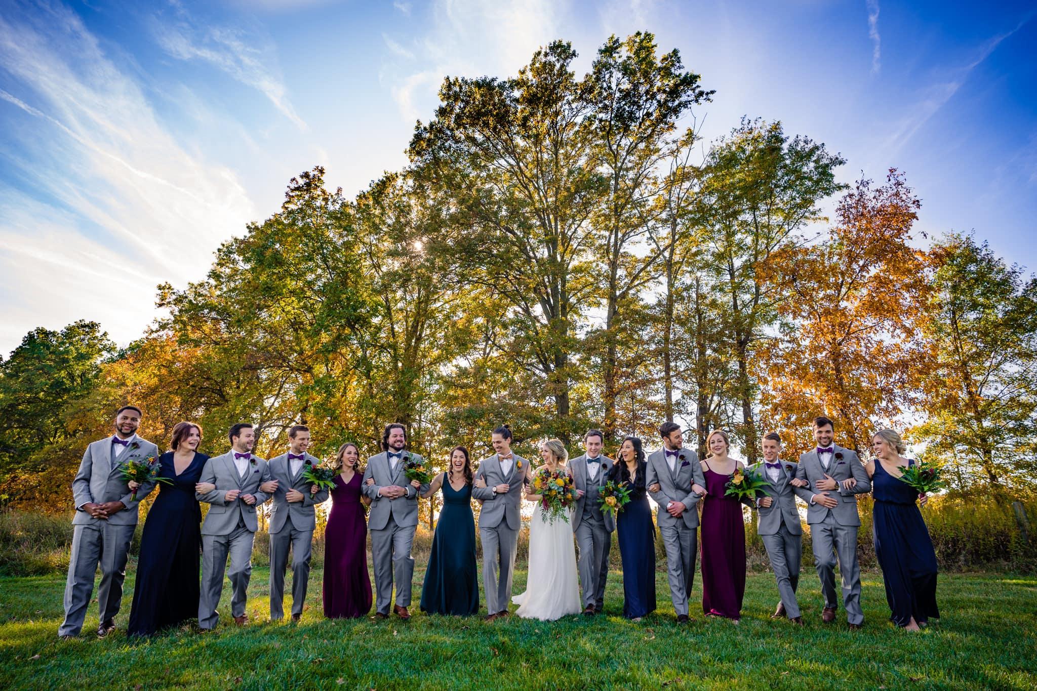 Wedding party locked arm in arm for fun wedding photo