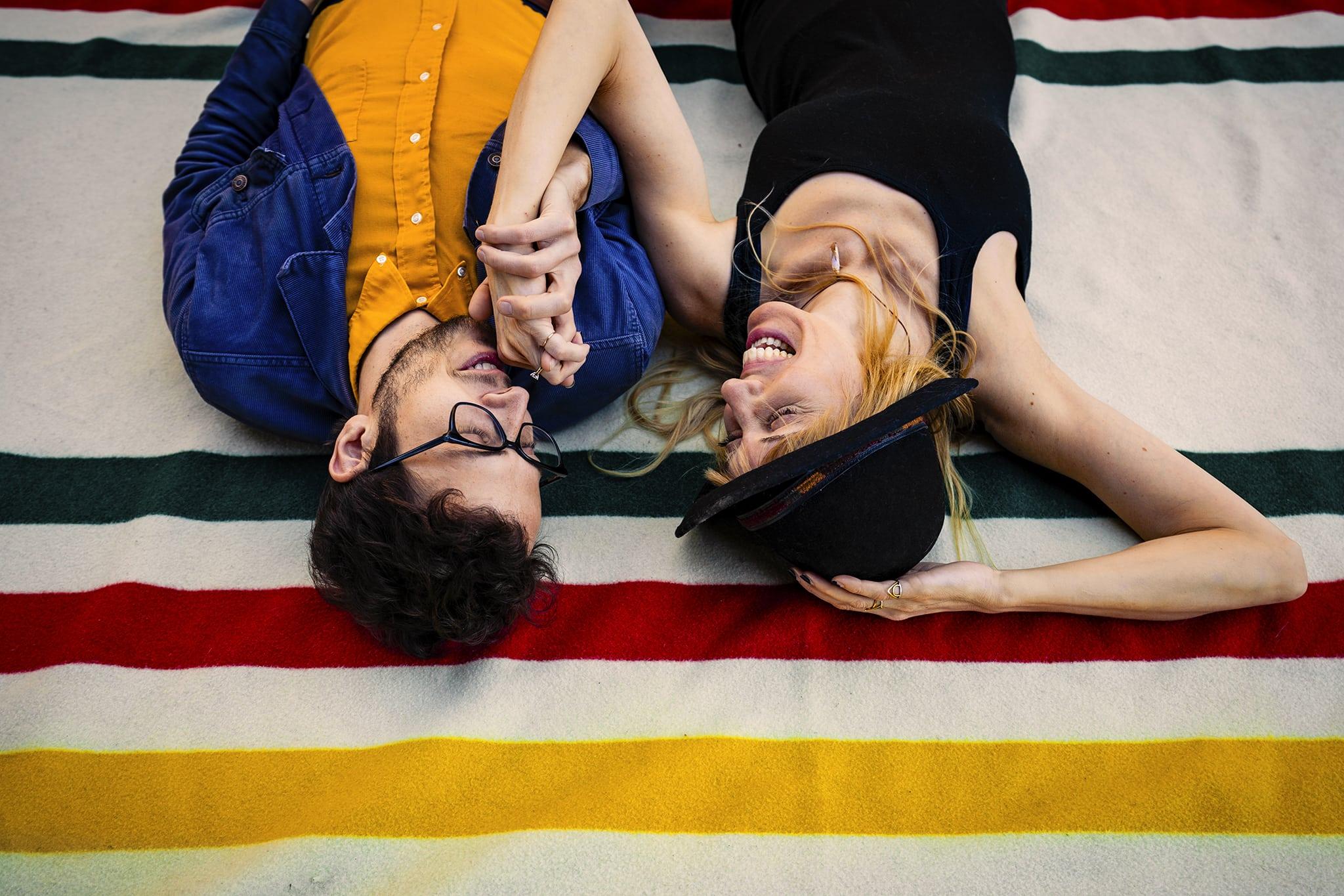 Couple lying on Pendleton blanket