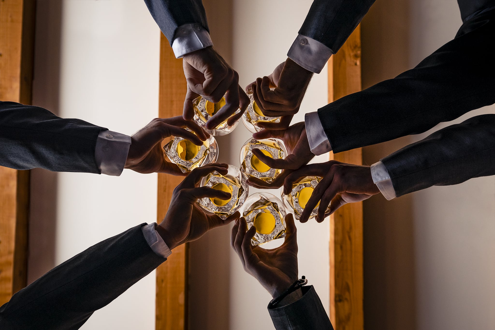 Groomsmen toast whiskey