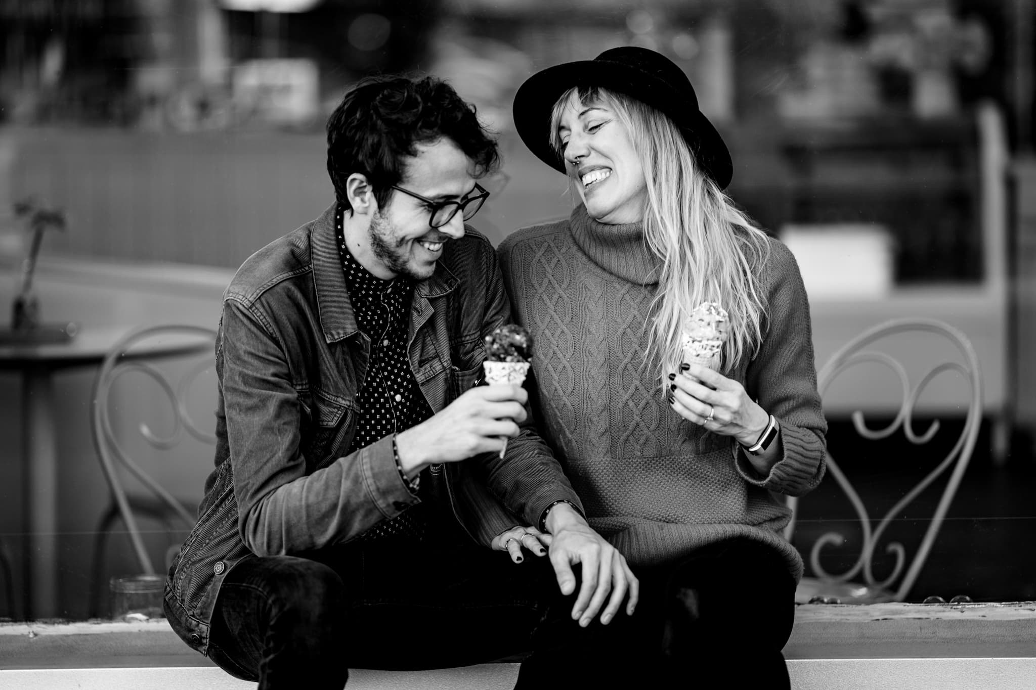 Man and woman enjoy ice cream together at Kelli's Bakery in Austin by Austin Wedding Photographer Studio 22 Photography
