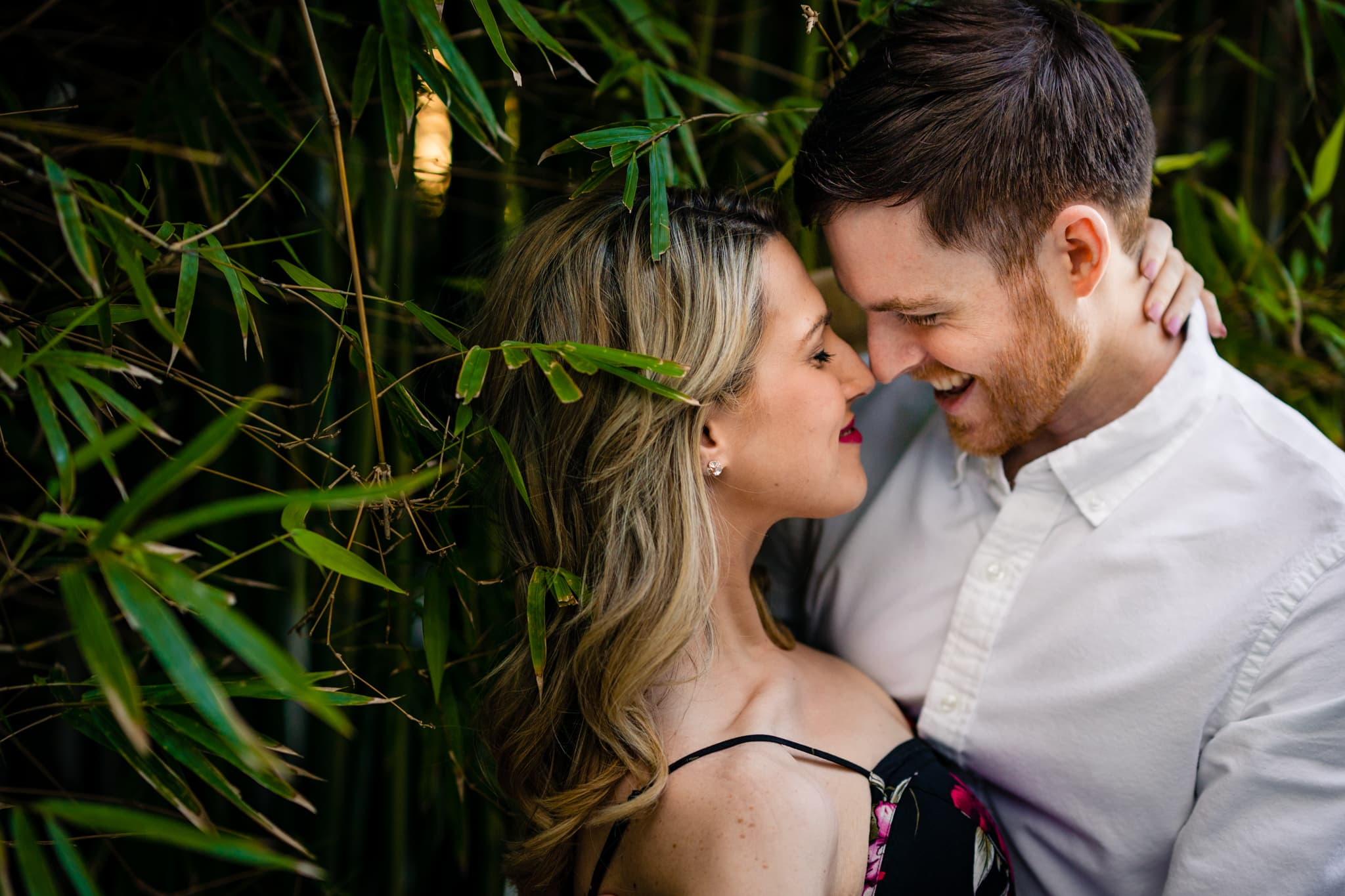 Woman embraces man with both smiling outdoors near bamboo in Orlando, Florida by Dayton Wedding Photographer Studio 22 Photography