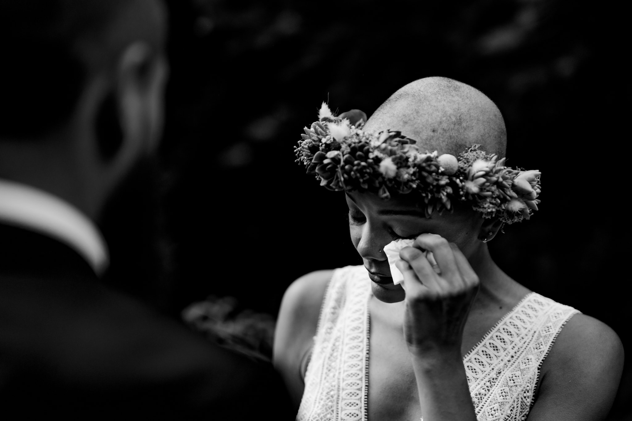 Bride wipes a tear from her eye during wedding ceremony in Cincinnati, Ohio