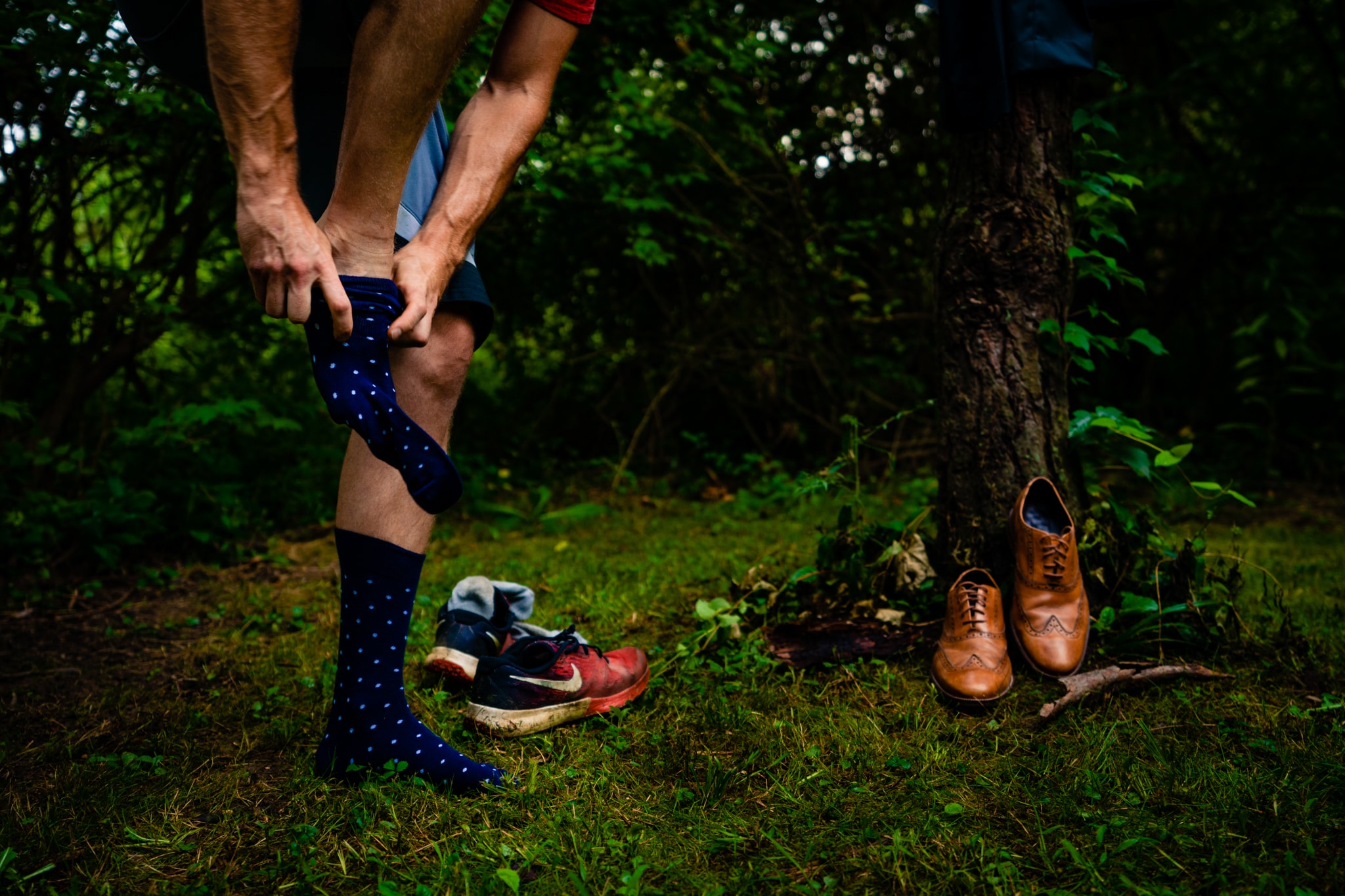 Man puts dress socks on outside before his wedding in Cincinnati, Ohio