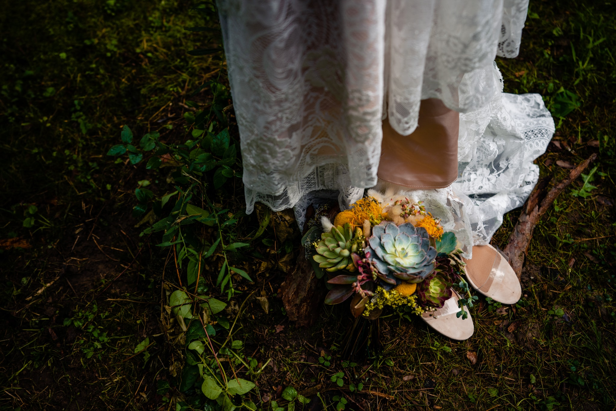 Bride's wedding dress and shoes rest in the woods outside Cincinnati, Ohio.